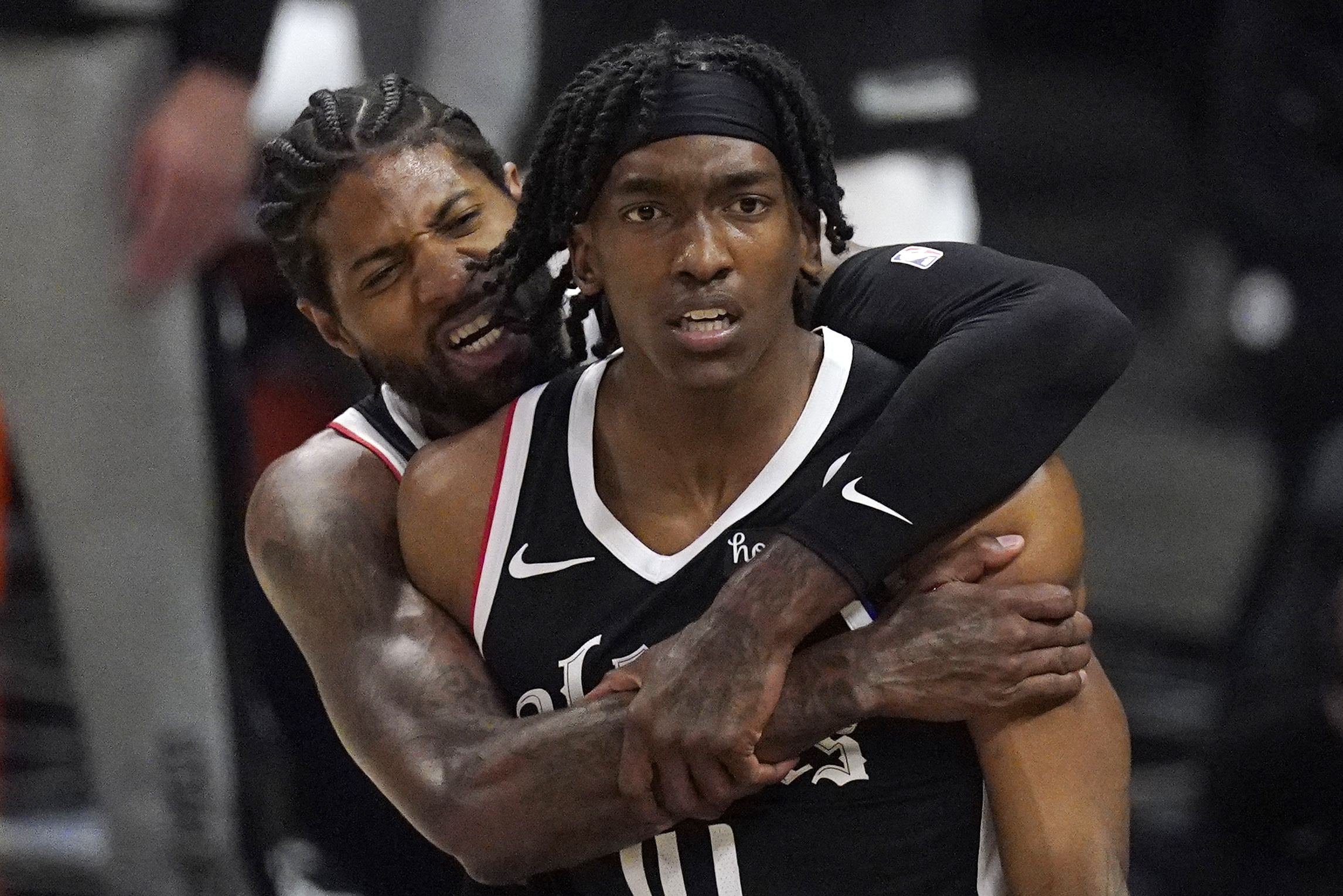 Los Angeles Clippers guard Terance Mann celebrates with Paul George