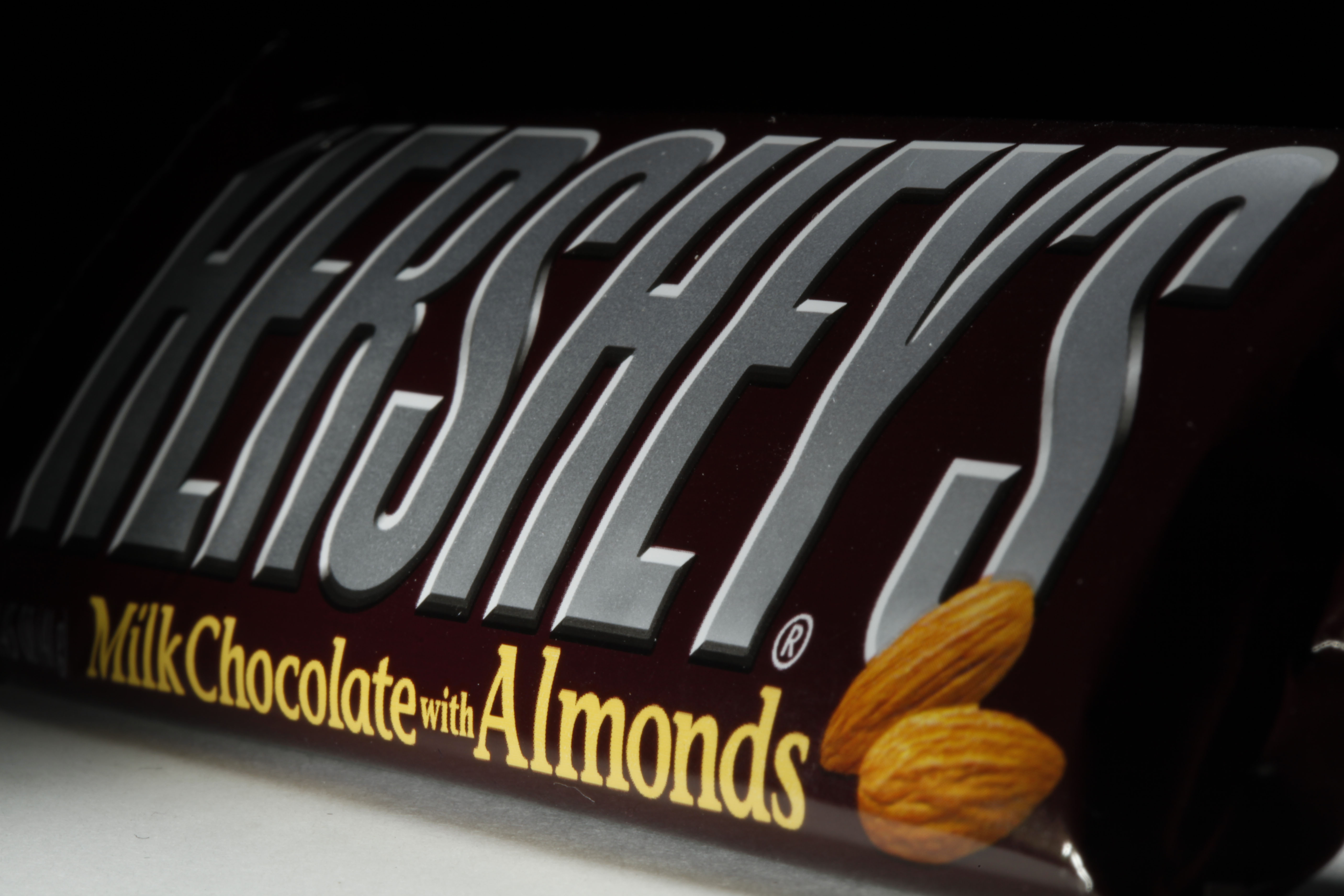 This April 21, 2020 file photo shows a Hershey's chocolate bar with almonds in Philadelphia. Hershey says its Halloween candy sales were up slightly this year despite lower enthusiasm for trick-or-treating amid the pandemic.