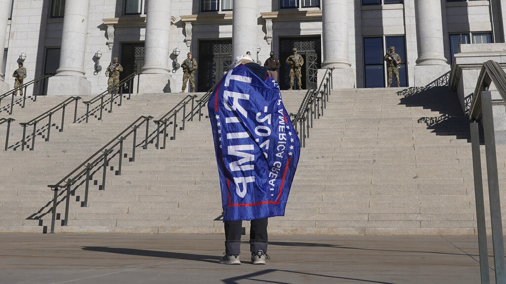 A Donald Trump supporter stands in front of the Utah State Capitol in Salt Lake City.