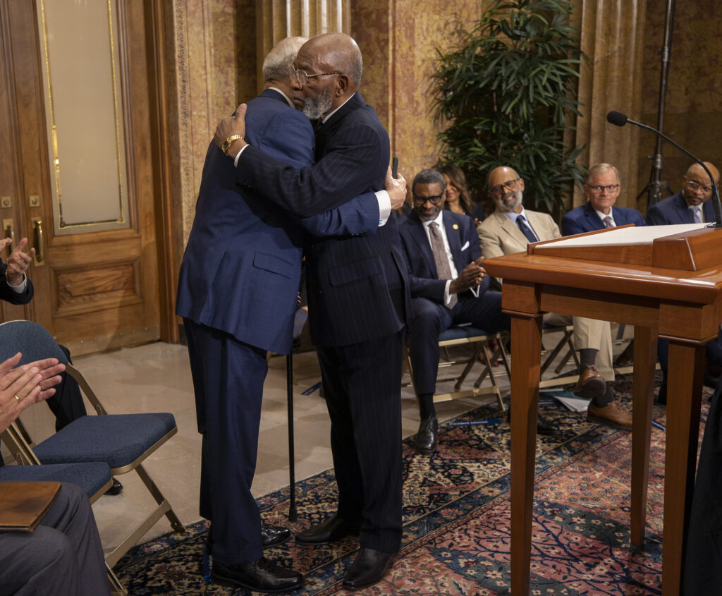 President Russell M. Nelson of The Church of Jesus Christ of Latter-day Saints and the Rev. Amos C. Brown, representing the NAACP, embrace at the announcement of a new partnership between the two organizations during a press conference at the Church Administration Building in Salt Lake City.