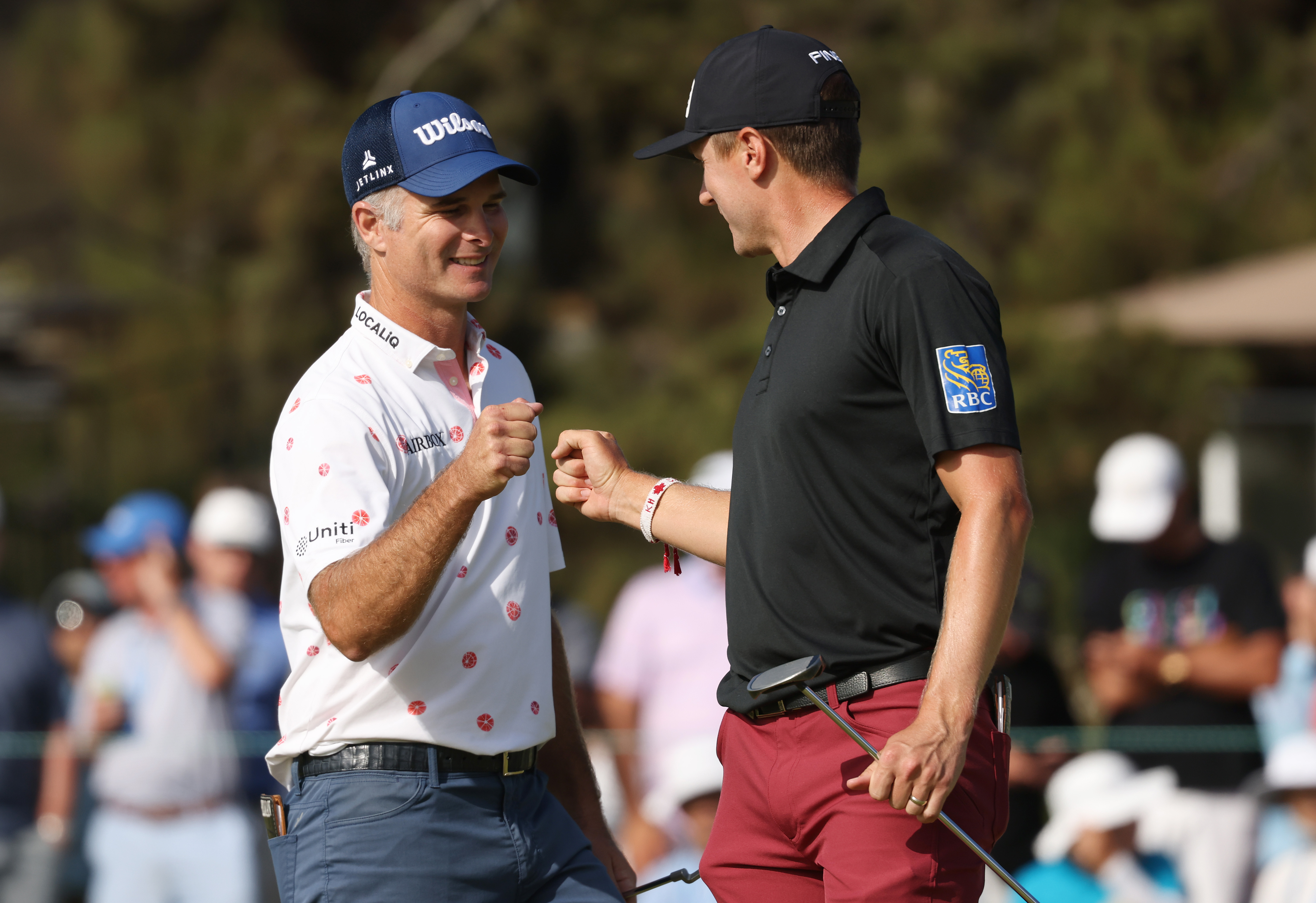 Kevin Streelman of the United States celebrates his putt on the 18th green with Mackenzie Hughes of Canada during the third round of the 2021 U.S. Open at Torrey Pines Golf Course (South Course) on June 19, 2021 in San Diego, California.