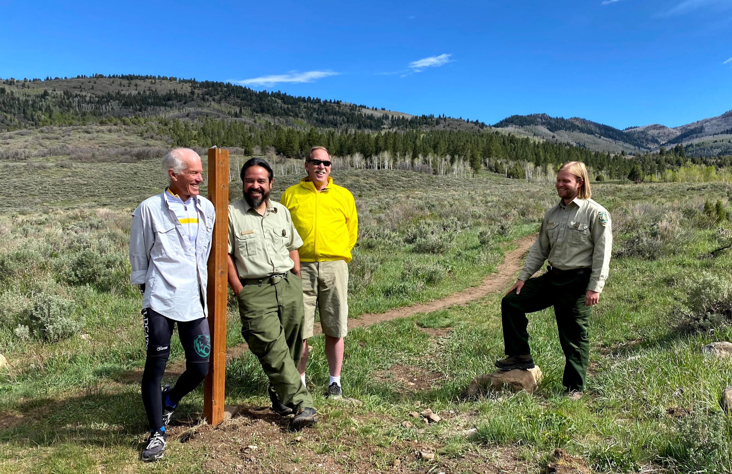Tom Noaker, left, and Les England, in the yellow shirt, of the South Summit Trails Foundation, stand at the entrance to the new Slate Creek Mountain Bike Trail with Daniel Jauregui, leaning against the pole, and Brent Freeman of the U.S. Forest Service. The public-private collaboration between the two entities created what is believed to be the first mountain bike-specific trail constructed on national forest terrain in Utah.