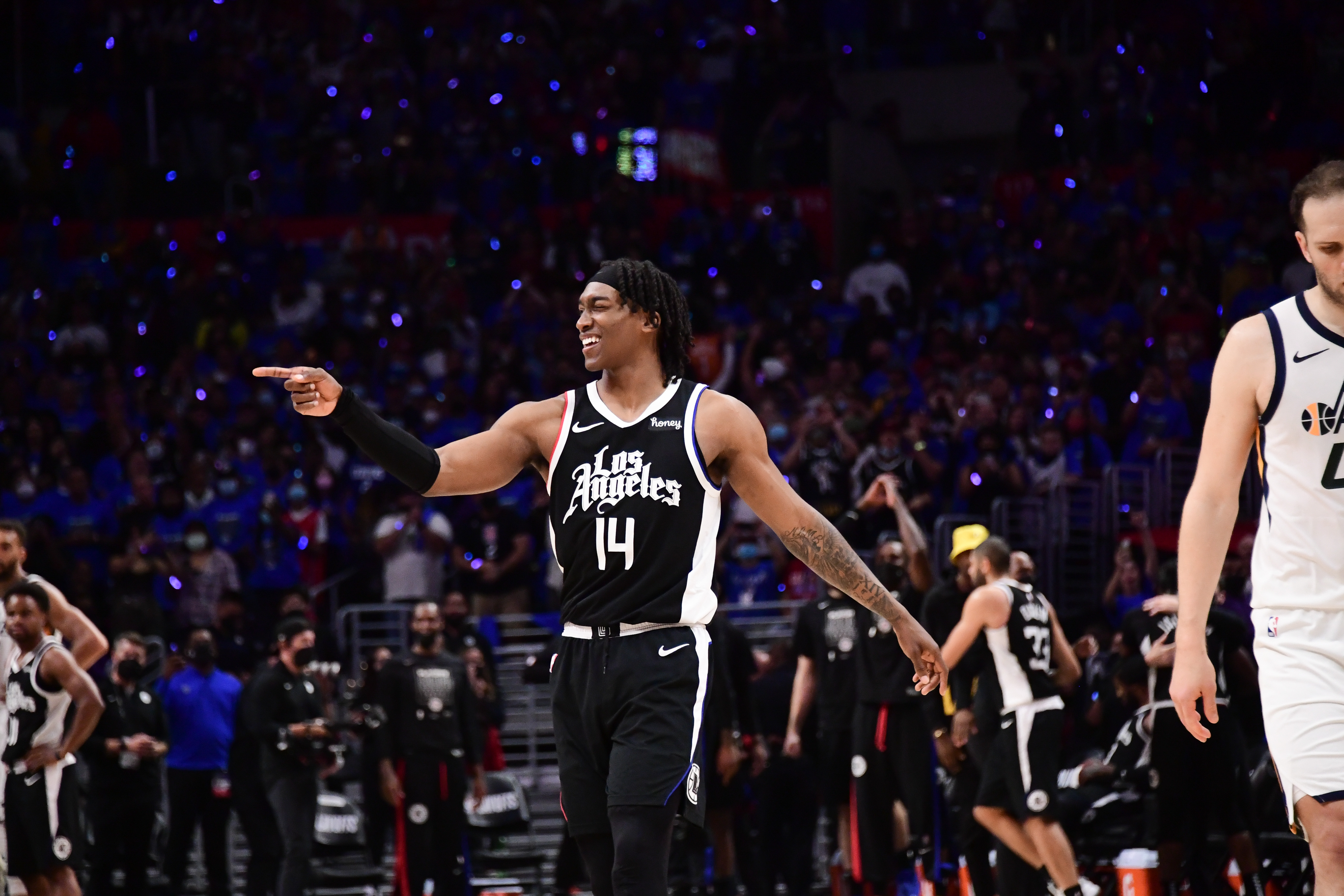 Terance Mann of the LA Clippers smiles during the game against the Utah Jazz during Round 2, Game 6 of the 2021 NBA Playoffs on June 18, 2021 at STAPLES Center in Los Angeles, California.