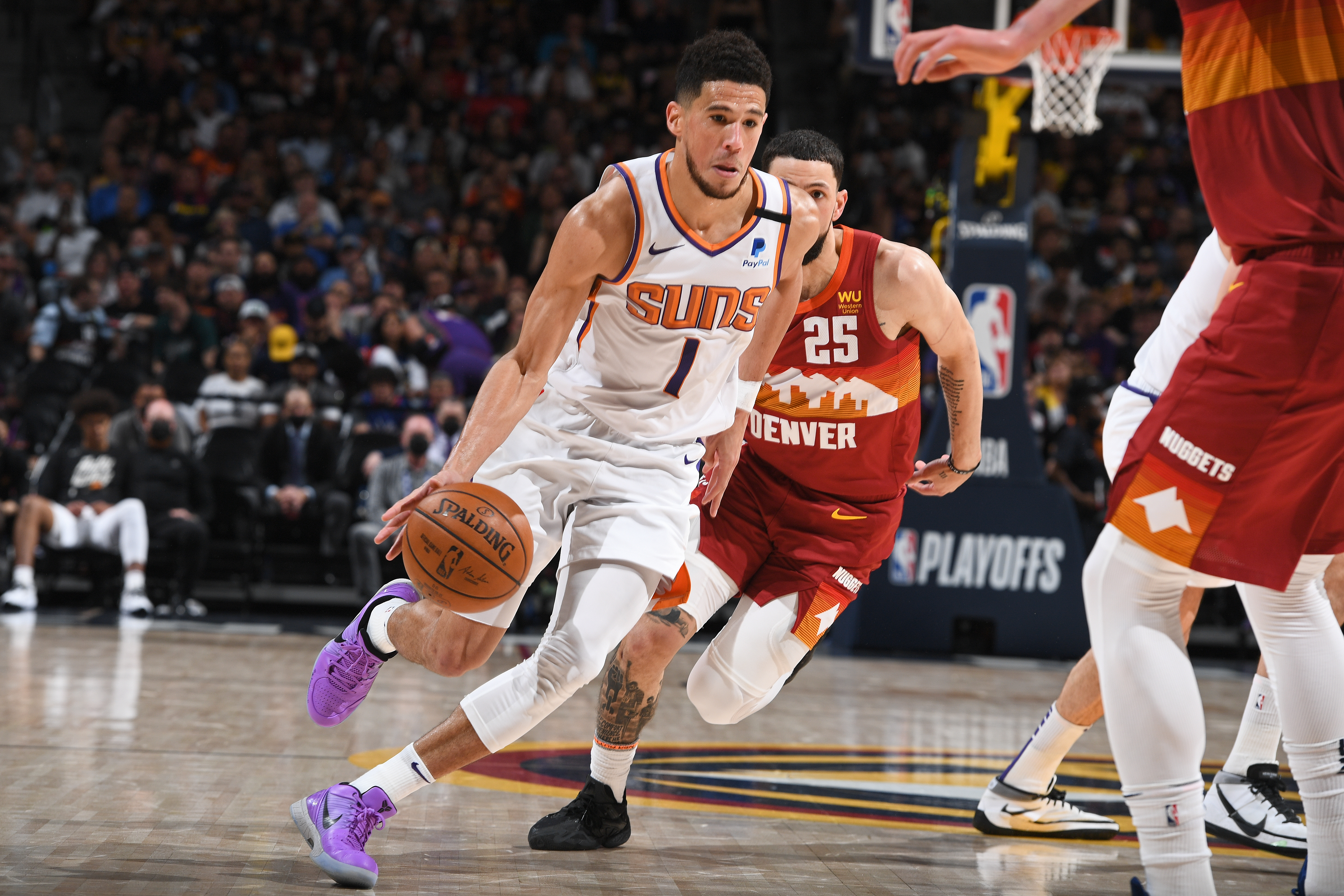 Devin Booker of the Phoenix Suns dribbles the ball during Round 2, Game 4 of the 2021 NBA Playoffs on June 13, 2021 at the Ball Arena in Denver, Colorado.