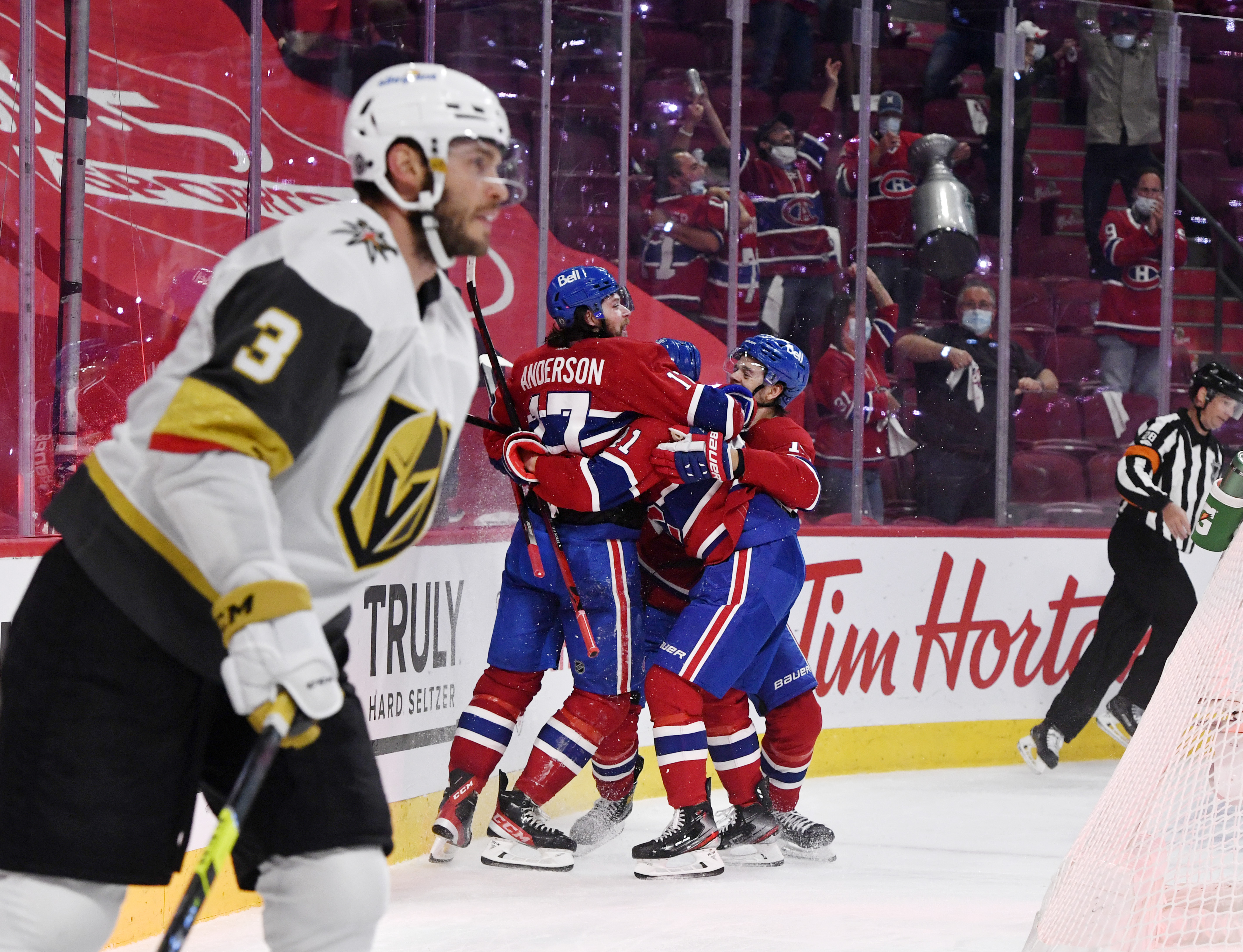 Montreal Canadiens forward Josh Anderson (17) reacts with teammates forward Paul Byron (41) and forward Jesperi Kotkaniemi (15) after scoring the winning goal during the overtime period in game three of the 2021 Stanley Cup Semifinals against the Vegas Golden Knights at the Bell Centre.