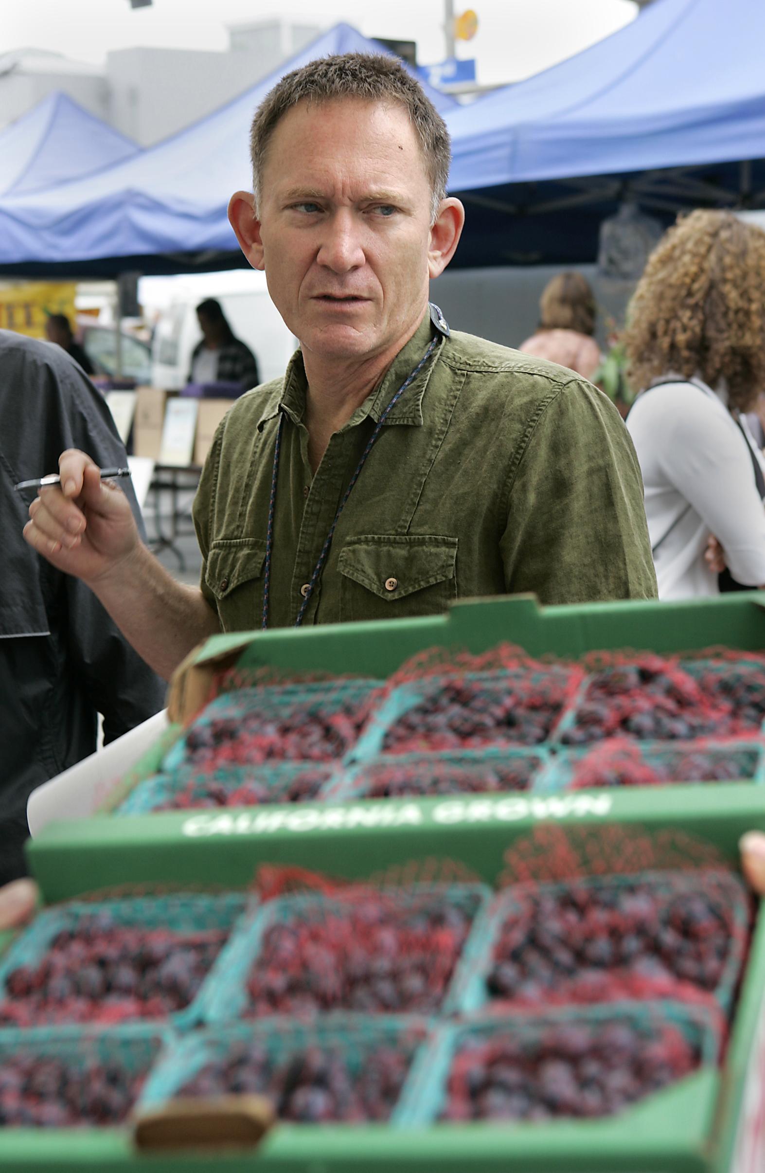 Photo of chef Mark Peel of Campanile shopping for berries at the Santa Monica Farmers Market, Wedne