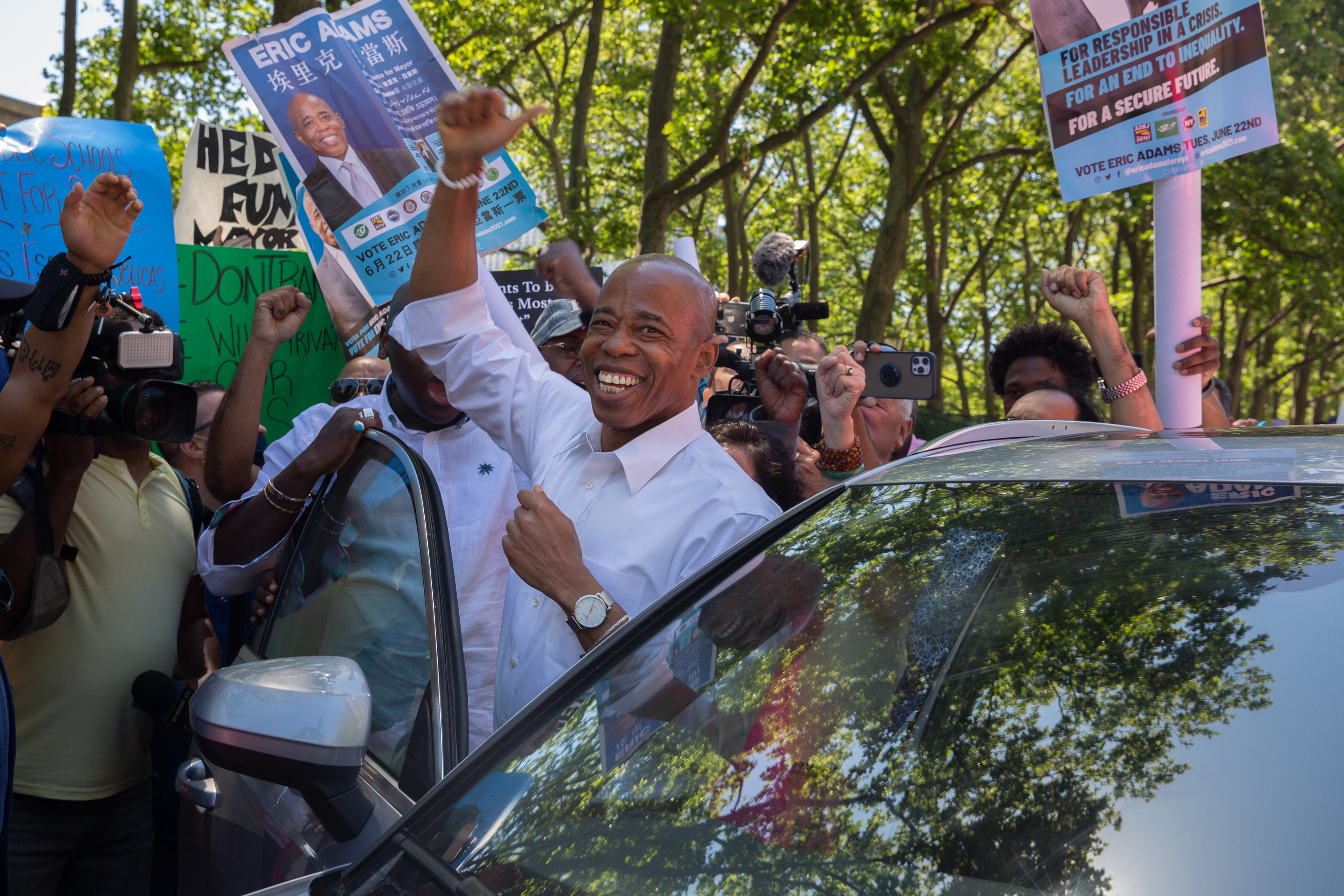 Brooklyn Borough President and mayoral candidate Eric Adams leaves a rally while protesters try to disrupt the event at Cadman Plaza, June 16, 2021.