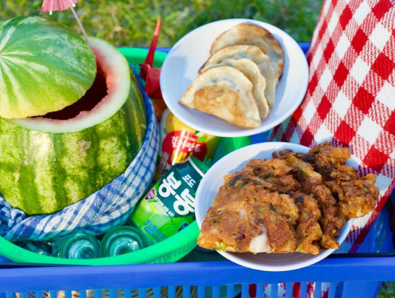 picnic set up with dumplings, watermelon