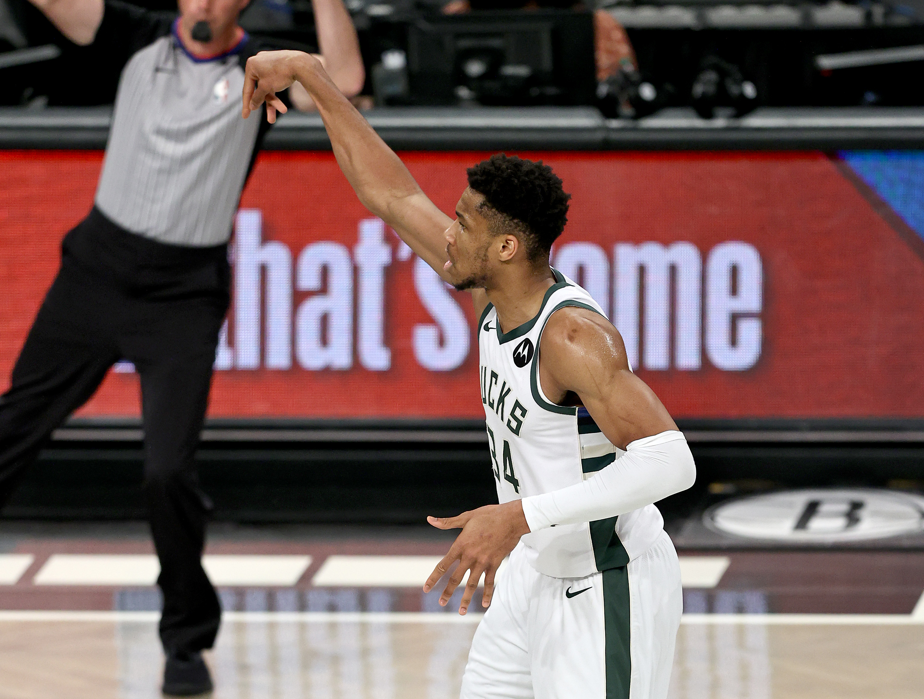 Giannis Antetokounmpo #34 of the Milwaukee Bucks celebrates his three point shot in the first quarter against the Brooklyn Nets during game seven of the Eastern Conference second round at Barclays Center on June 19, 2021 in the Brooklyn borough of New York City.