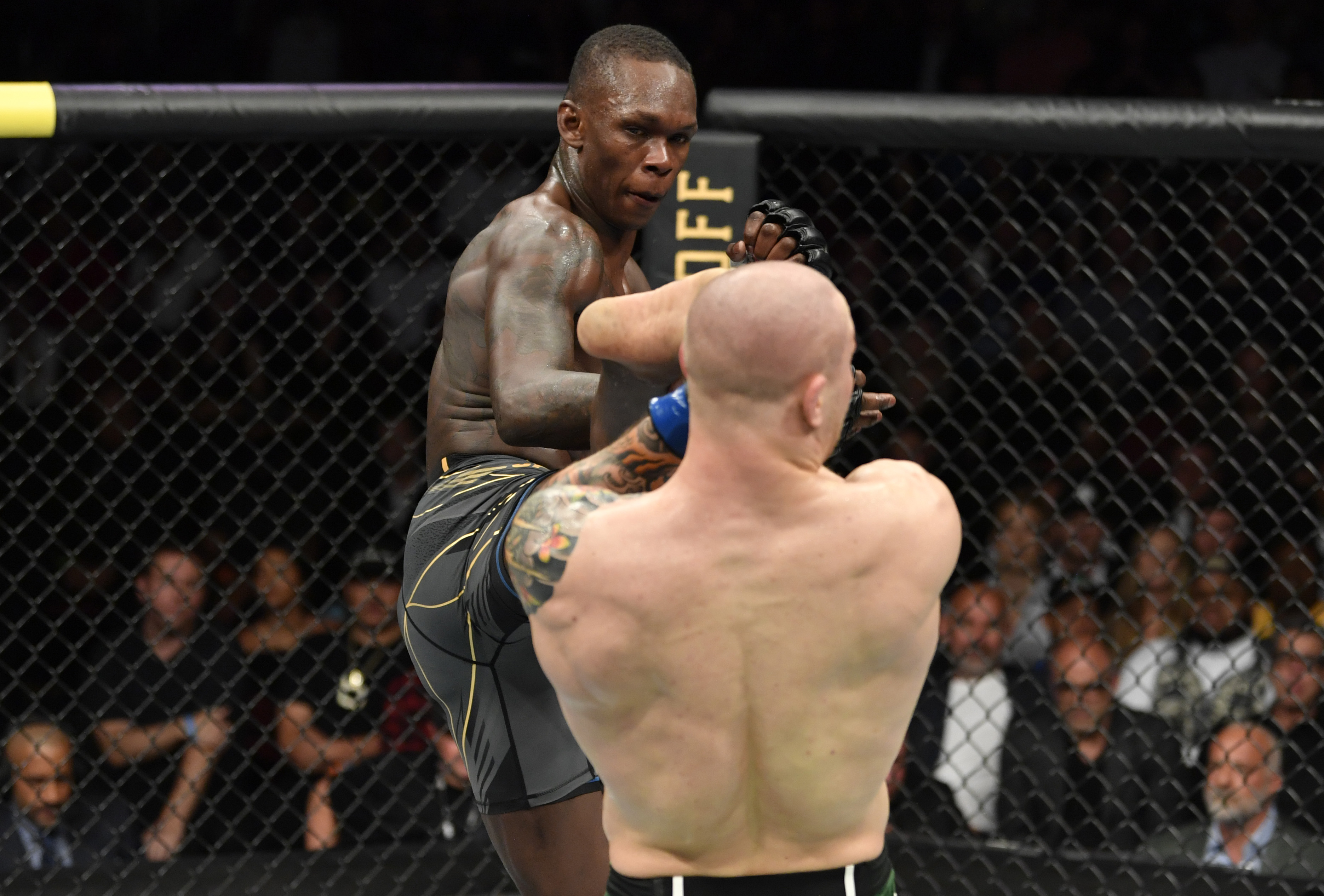 Israel Adesanya lands a kick on Marvin Vettori in the main event of UFC 263.