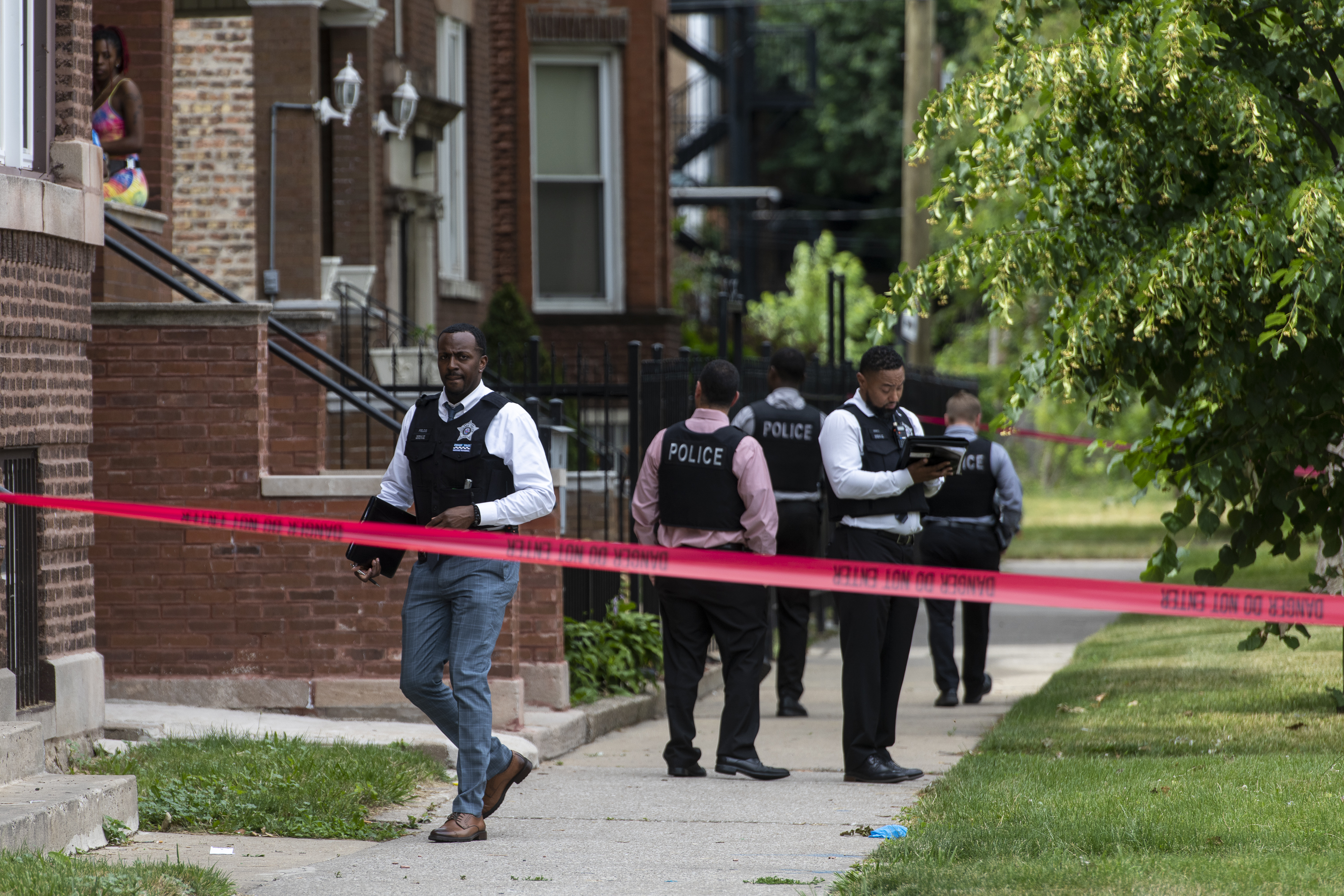 Chicago police work the scene where two people were shot, including a 4-year-old boy and a 17-year-old boy, in the 6500 block of South Ellis Avenue, Monday, June 21, 2021.