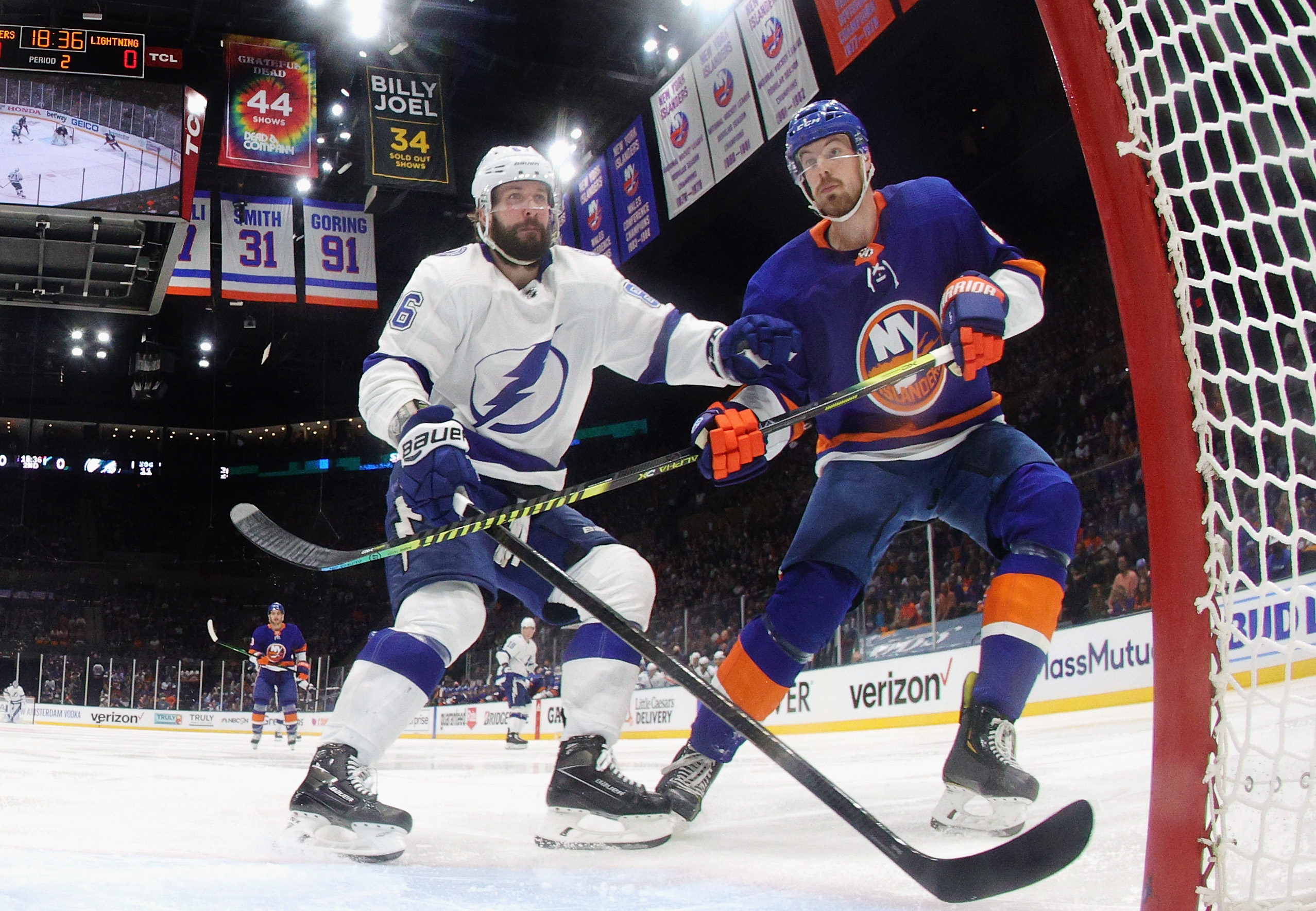 Nikita Kucherov #86 of the Tampa Bay Lightning skates against Scott Mayfield #24 of the New York Islanders in Game Four of the Stanley Cup Semifinals during the 2021 Stanley Cup Playoffs at the Nassau Coliseum on June 19, 2021 in Uniondale, New York. The Islanders defeated the Lightning 3-2.