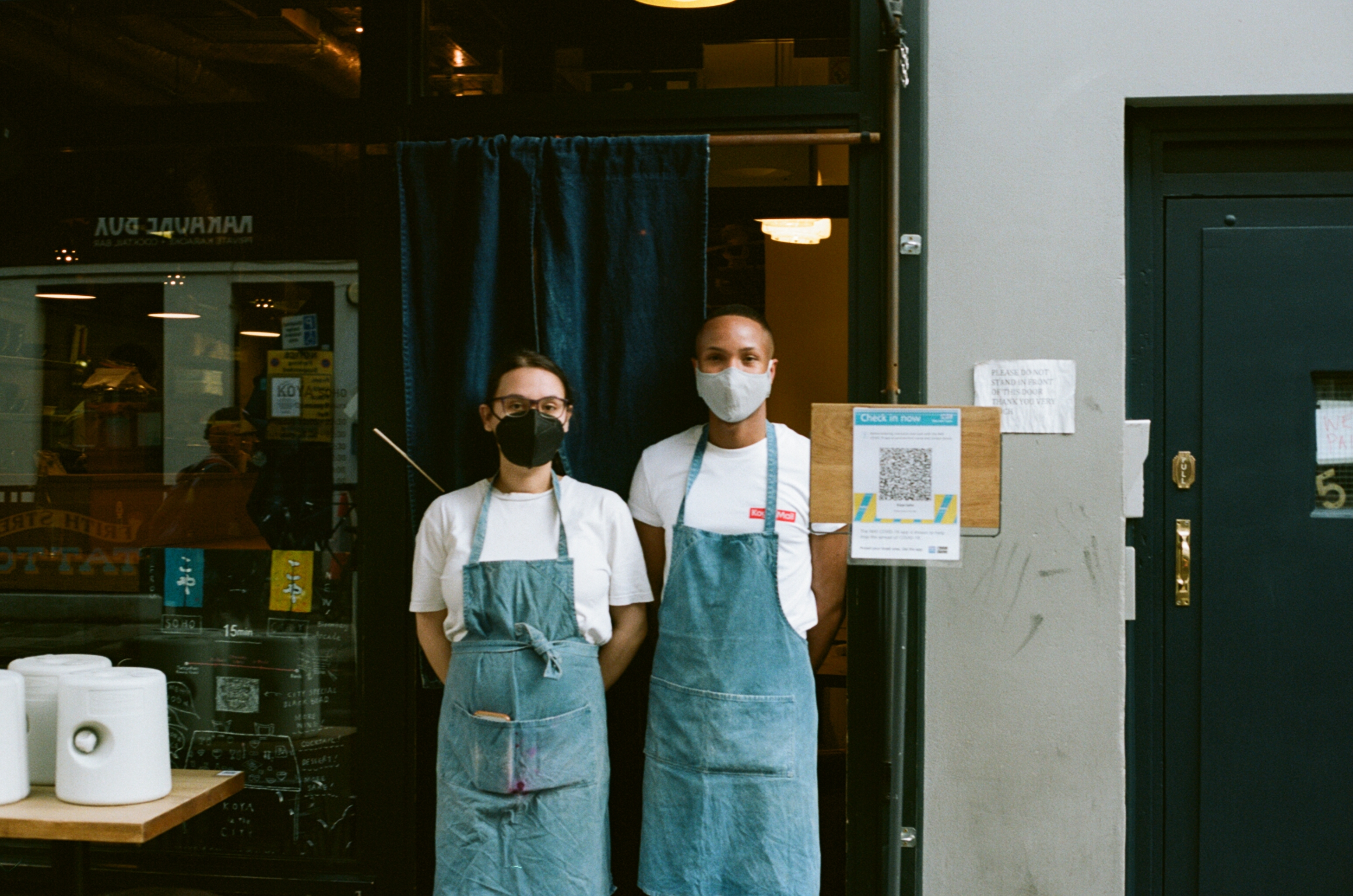 Two workers stand outside Koya in Soho, London, in May 2021. One of the best restaurants and Japanese noodle bars in London