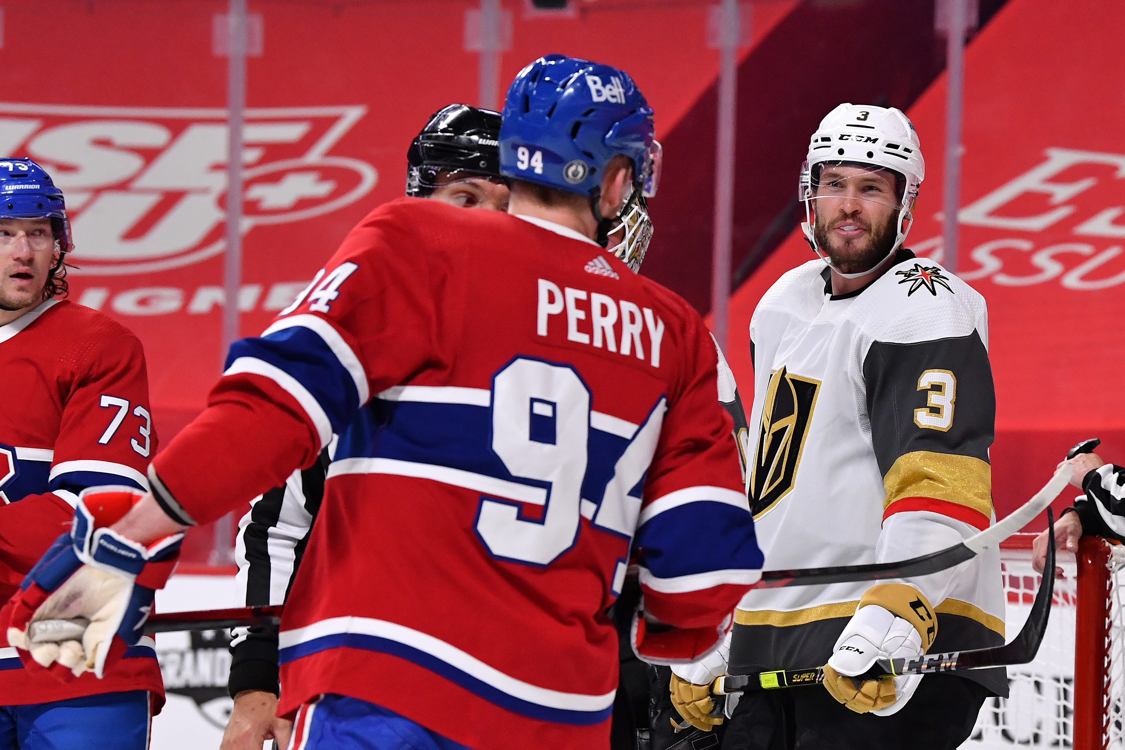 Brayden McNabb #3 of the Vegas Golden Knights and Corey Perry #94 of the Montreal Canadiens exchange words during the second period in Game Four of the Stanley Cup Semifinals of the 2021 Stanley Cup Playoffs at Bell Centre on June 20, 2021 in Montreal, Quebec.