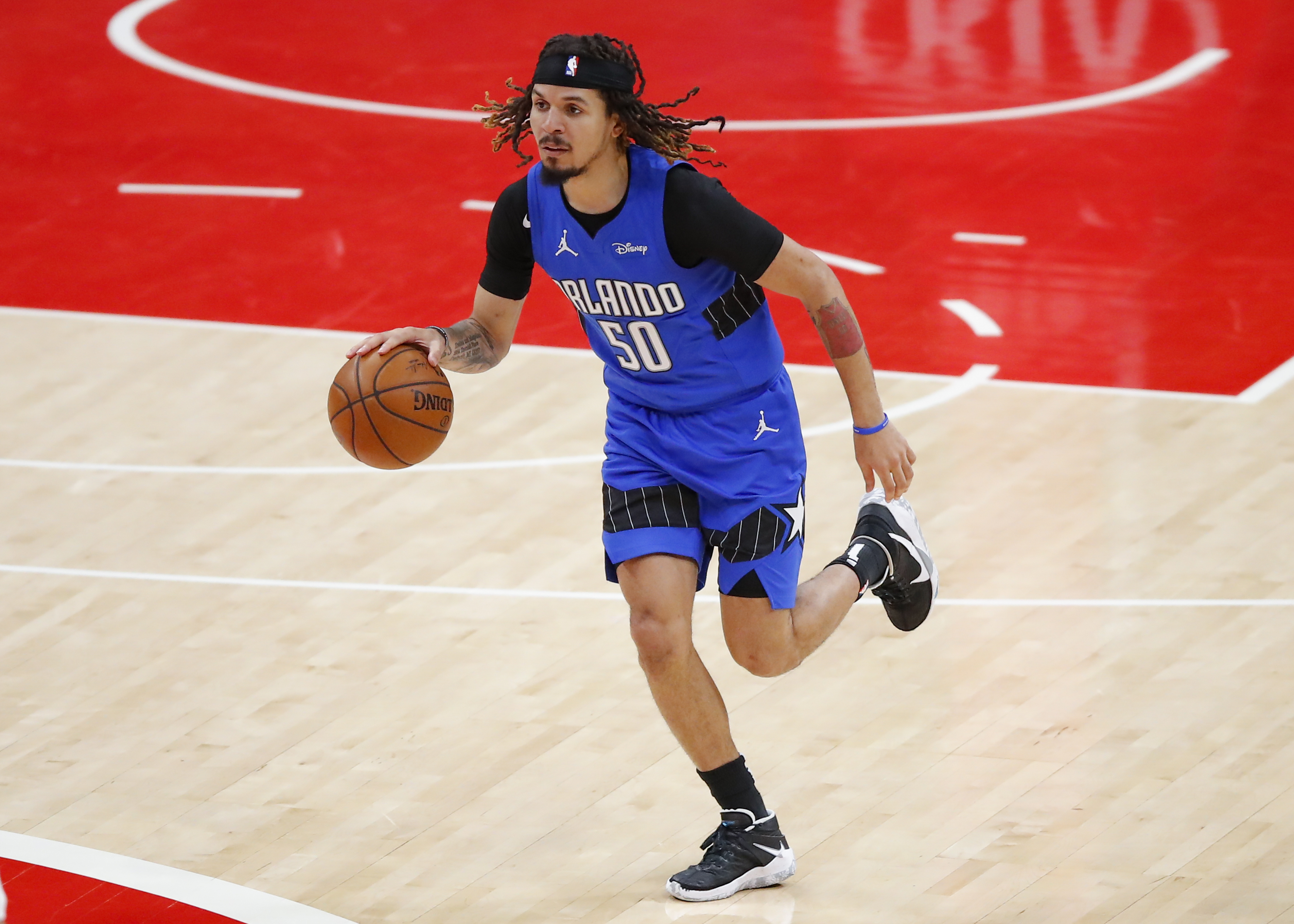 Cole Anthony of the Orlando Magic drives downcourt during the first half against the Atlanta Hawks at State Farm Arena on May 13, 2021 in Atlanta, Georgia.