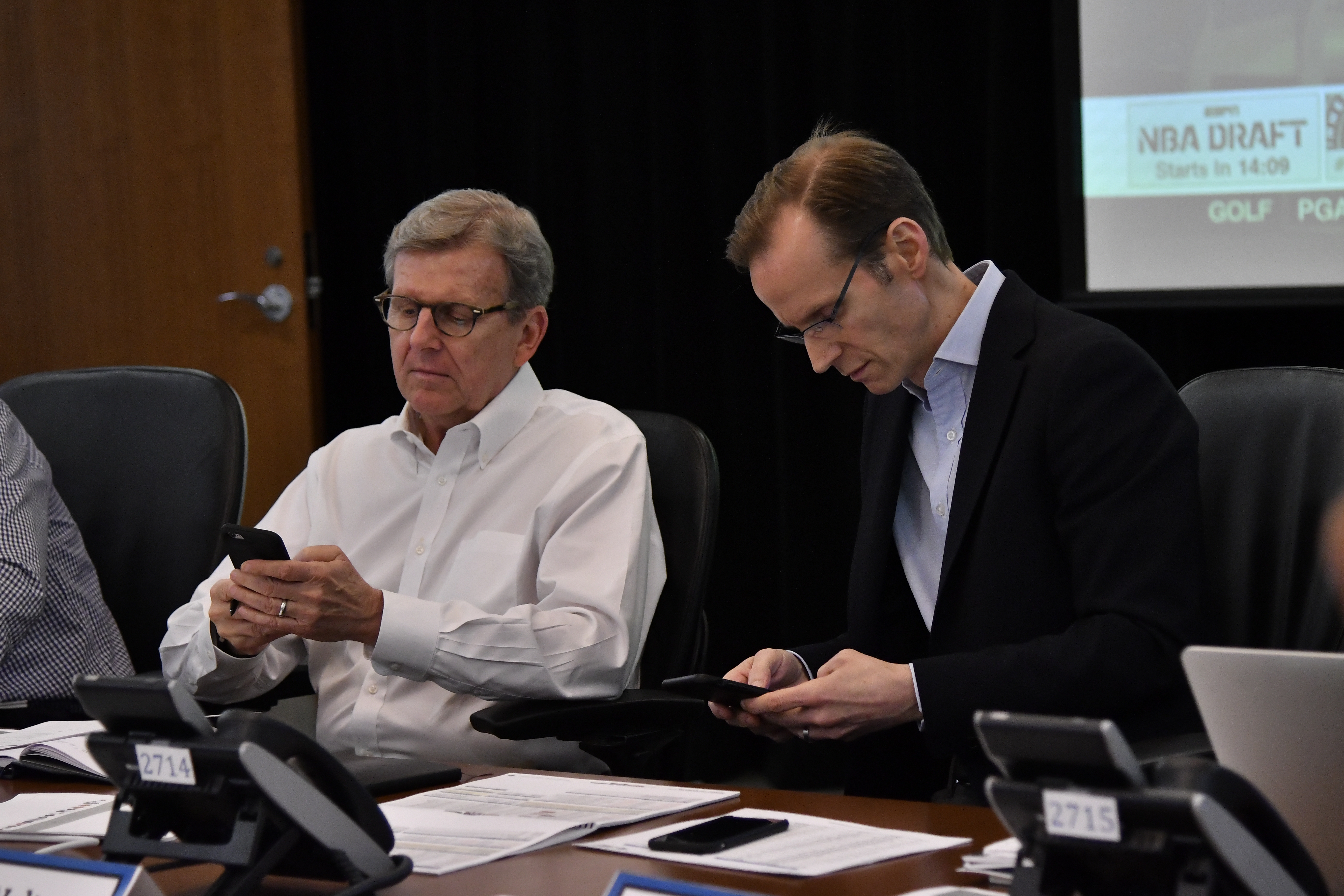 John Hammond and Jeff Weltman of the Orlando Magic talk in the war room during the 2017 NBA Draft on June 22, 2017 at Amway Center in Orlando, Florida.