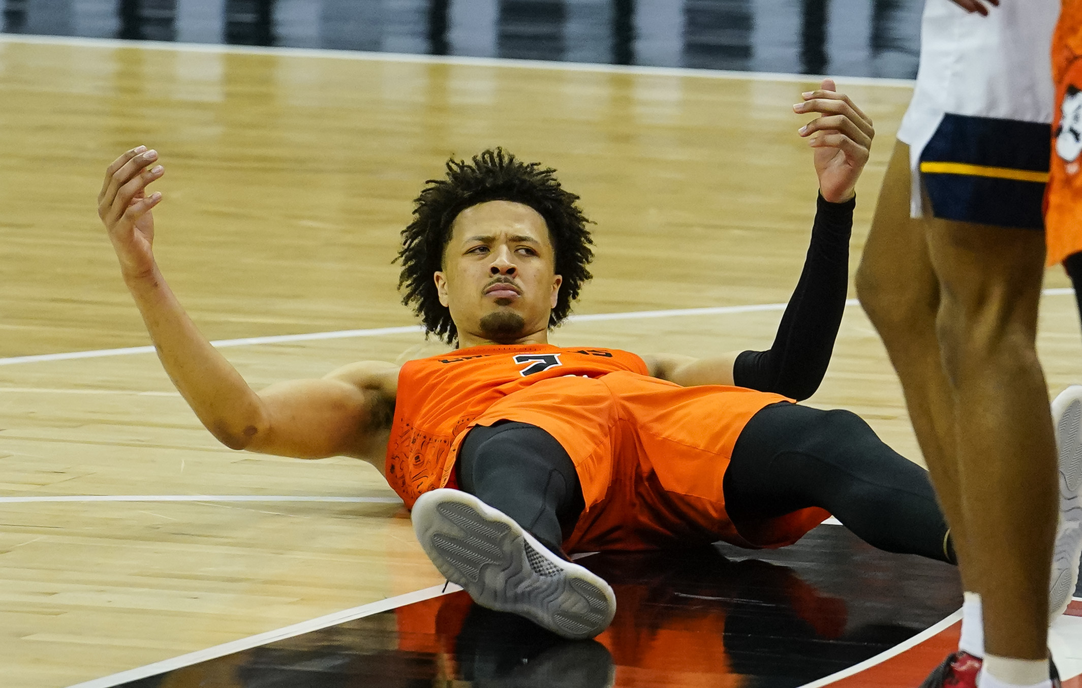 Oklahoma State Cowboys guard Cade Cunningham reacts after a play against the West Virginia Mountaineers during the second half at T-Mobile Center.