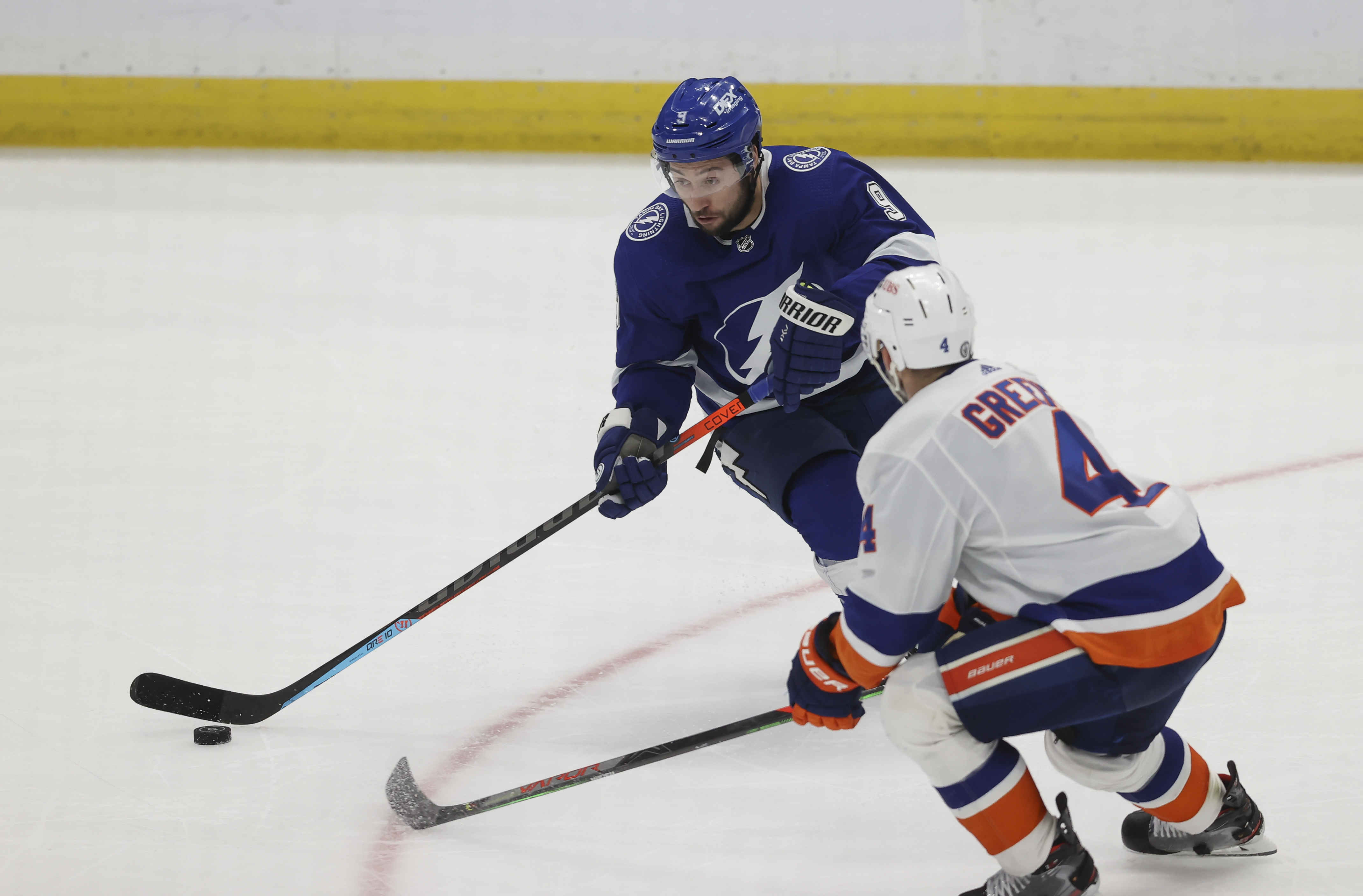 Tampa Bay Lightning center Tyler Johnson (9) skates against New York Islanders defenseman Andy Greene (4) in the third period of Game 5 of the Stanley Cup Playoffs Semifinals between the New York Islanders and Tampa Bay Lightning on June 21, 2021 at Amalie Arena in Tampa, FL.