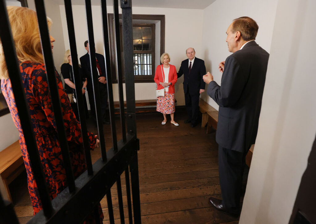 Elder Quentin L. Cook of the Quorum of the Twelve Apostles of The Church of Jesus Christ of Latter-day Saints, with his wife, Sister Mary G. Cook, tour the historic Carthage Jail.