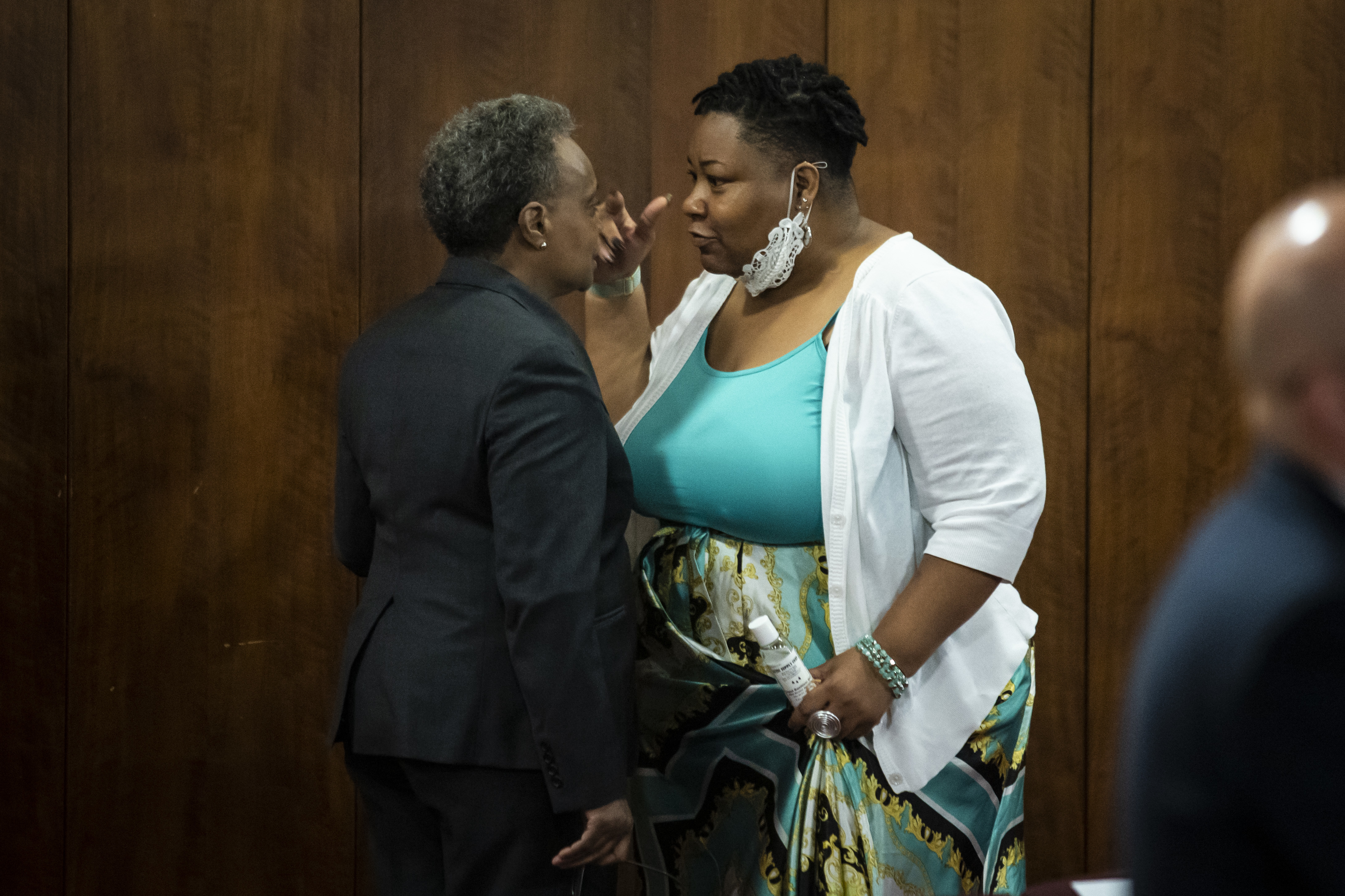 Mayor Lori Lightfoot and Ald. Jeanette Taylor (20th) in a heated discussion in the back of the Chicago City Council chambers on Wednesday before the Council meeting abruptly adjourned.
