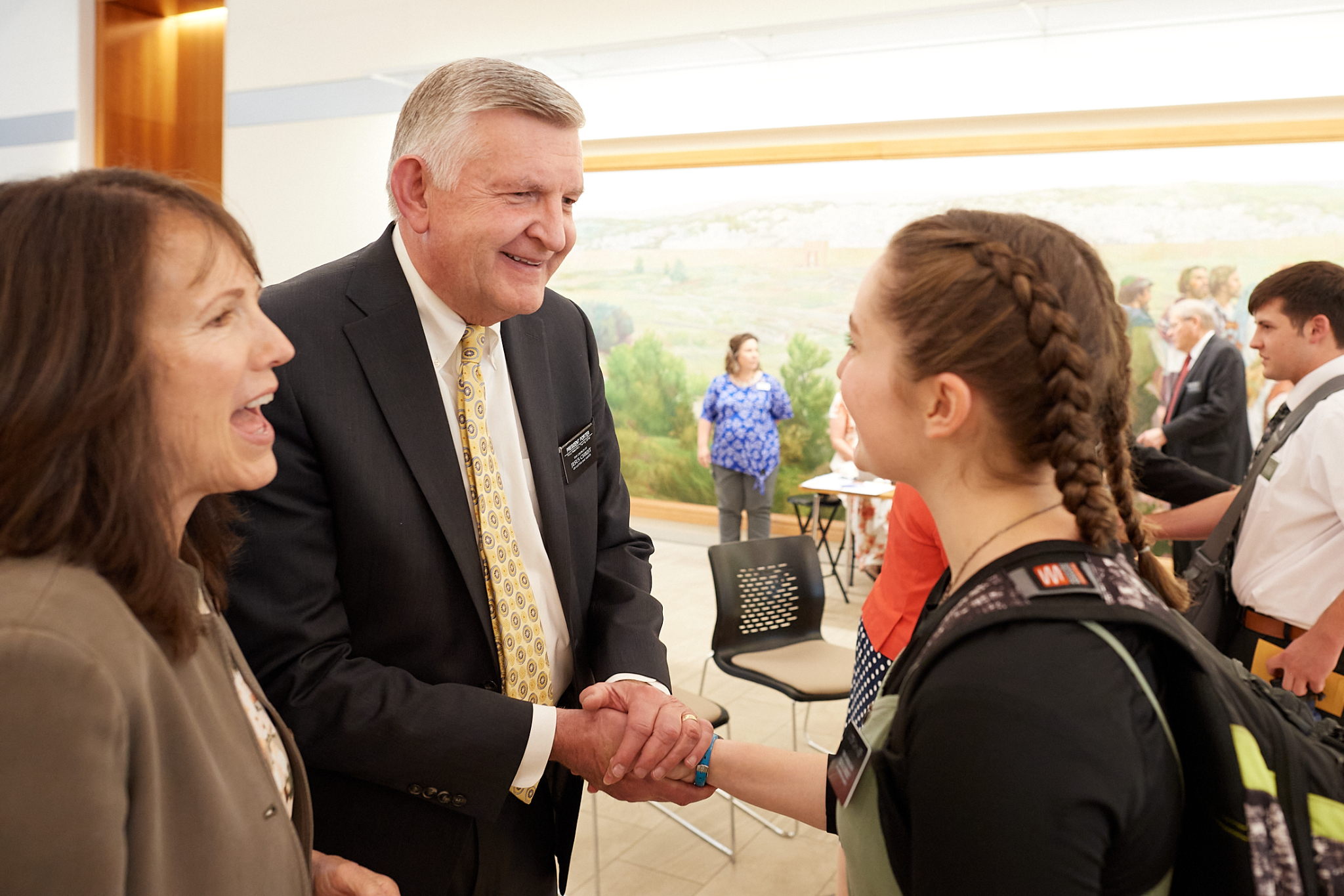 President Benson L. Porter and Sister Kerry Porter greet a new sister missionary at the Provo Missionary Training Center.