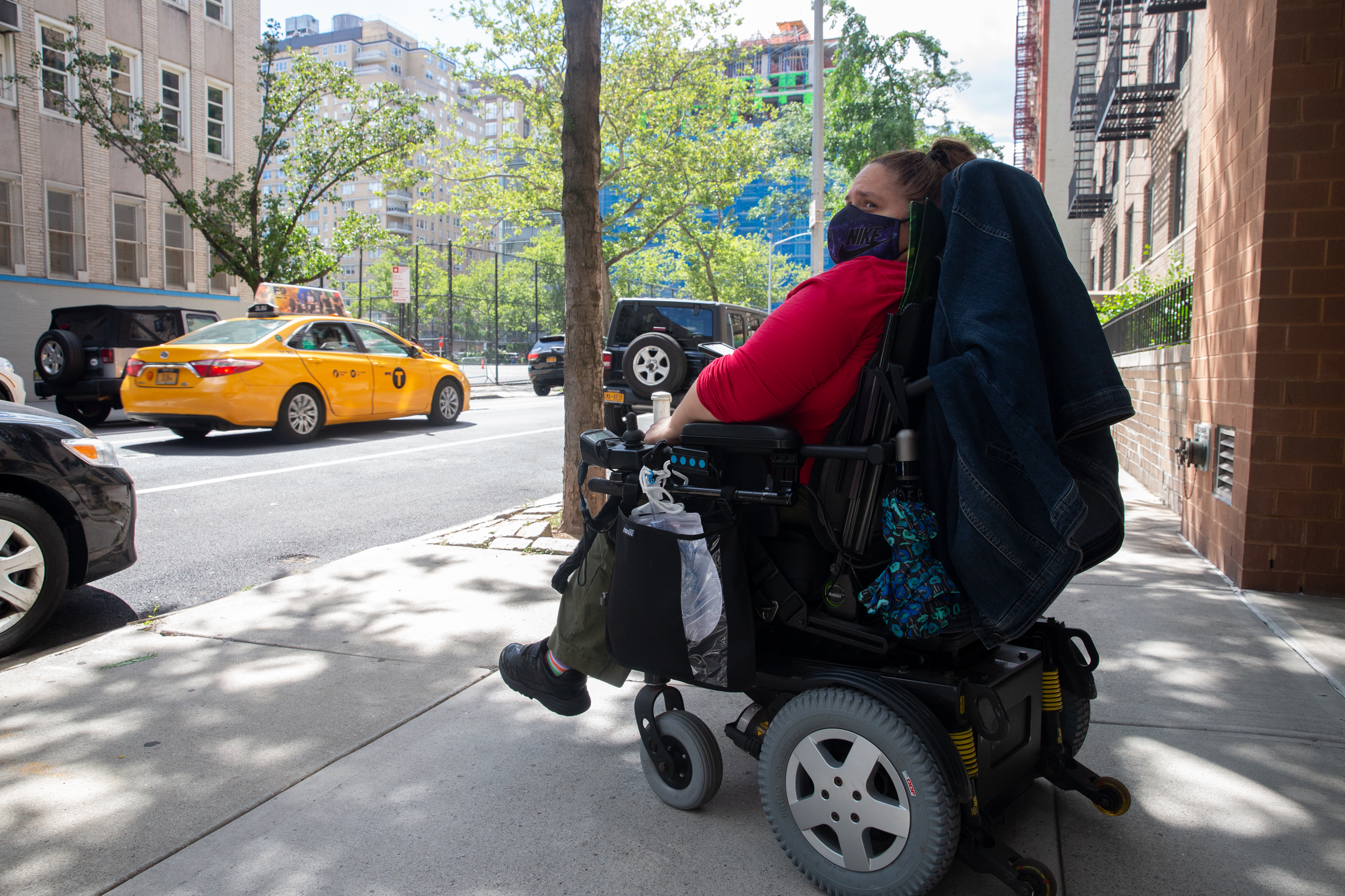 Milagros Franco waits for an accessible cab to pick her up from her Gramercy building, June 23, 2021.