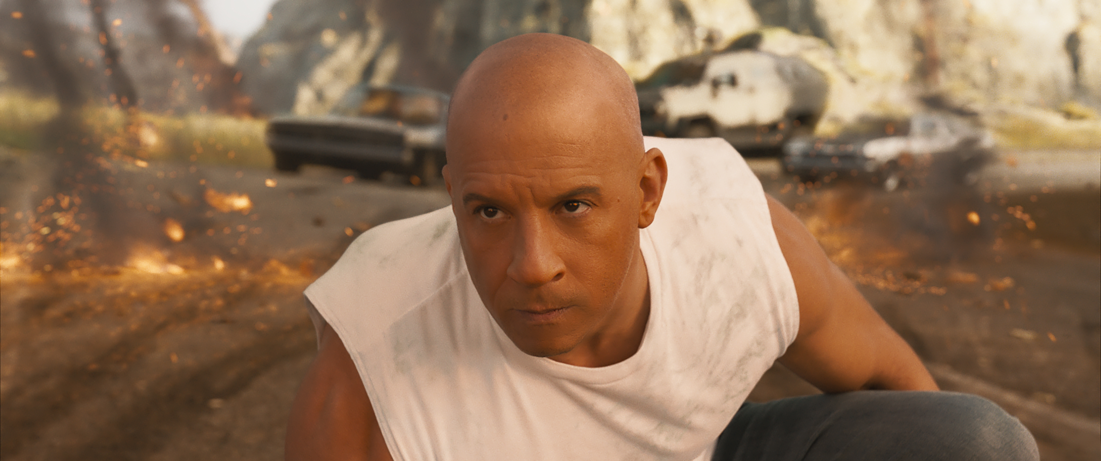 Vin Diesel stares intensely into the distance.