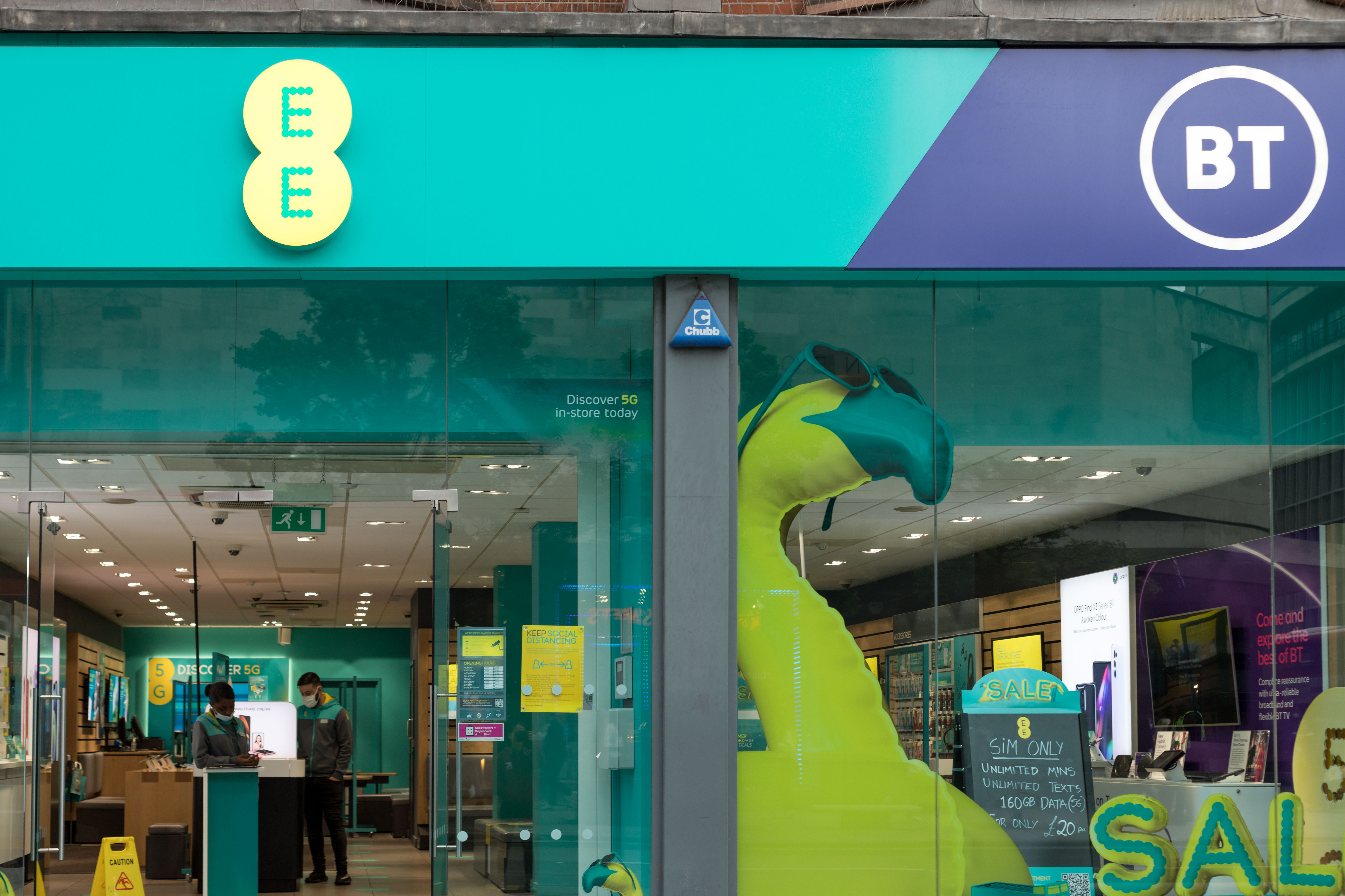 EE logo is seen at one of their stores on Oxford Street in...