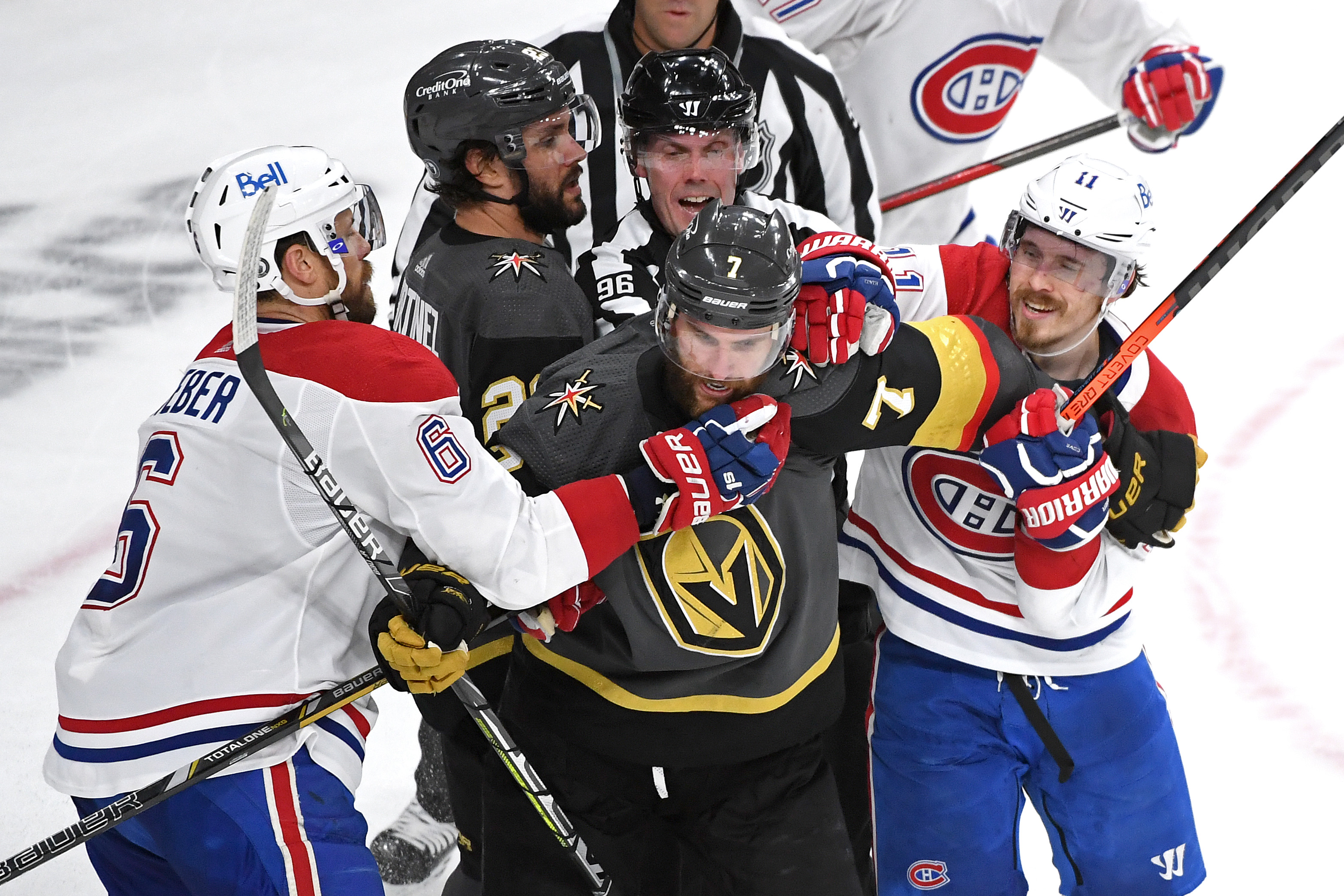 Alec Martinez #23 and Alex Pietrangelo #7 of the Vegas Golden Knights scuffle with Shea Weber #6 and Brendan Gallagher #11 of the Montreal Canadiens during the second period in Game 5 of the Stanley Cup Semifinals of the 2021 Stanley Cup Playoffs at T-Mobile Arena on June 22, 2021 in Las Vegas, Nevada.