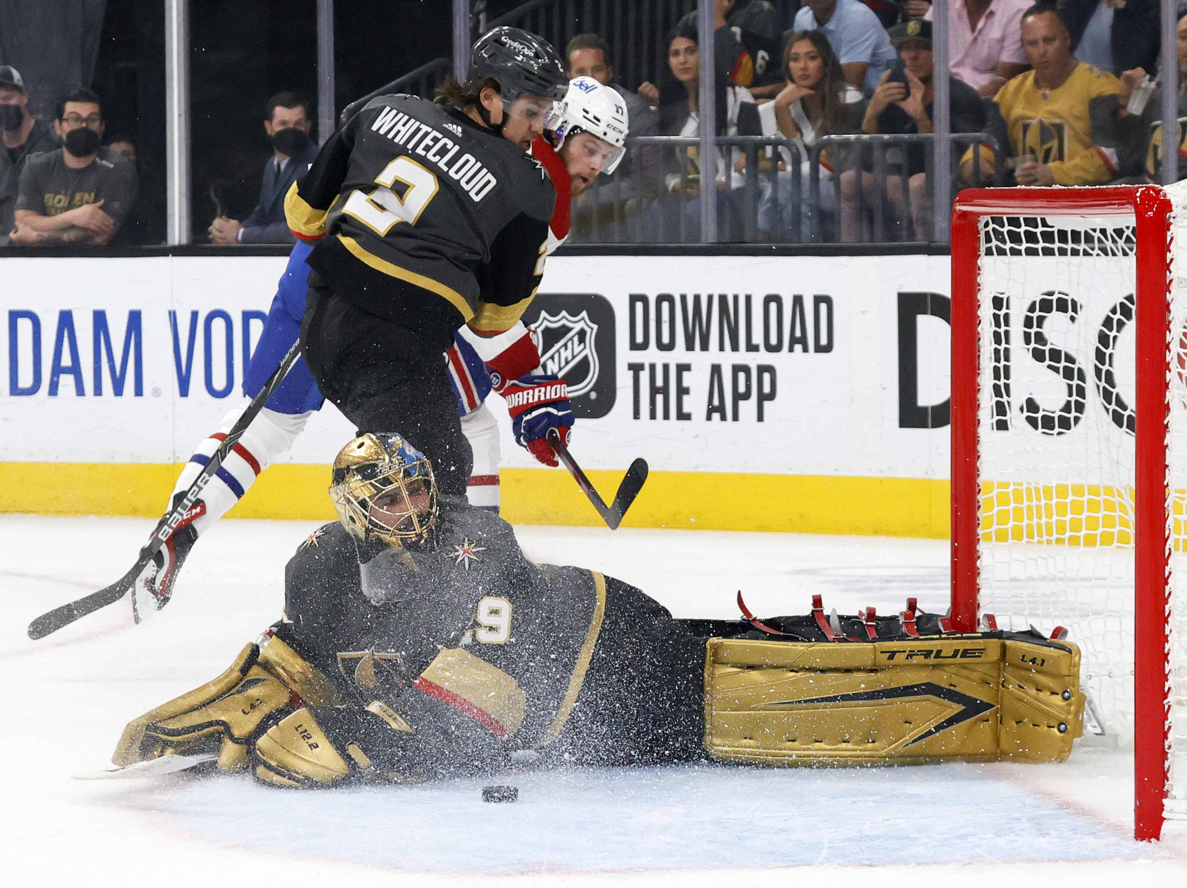 The puck gets away from Marc-Andre Fleury #29 of the Vegas Golden Knights after he made a save against Josh Anderson #17 of the Montreal Canadiens as Zach Whitecloud #2 of the Golden Knights defends in the first period in Game 5 of the Stanley Cup Semifinals of the 2021 Stanley Cup Playoffs at T-Mobile Arena on June 22, 2021 in Las Vegas, Nevada.