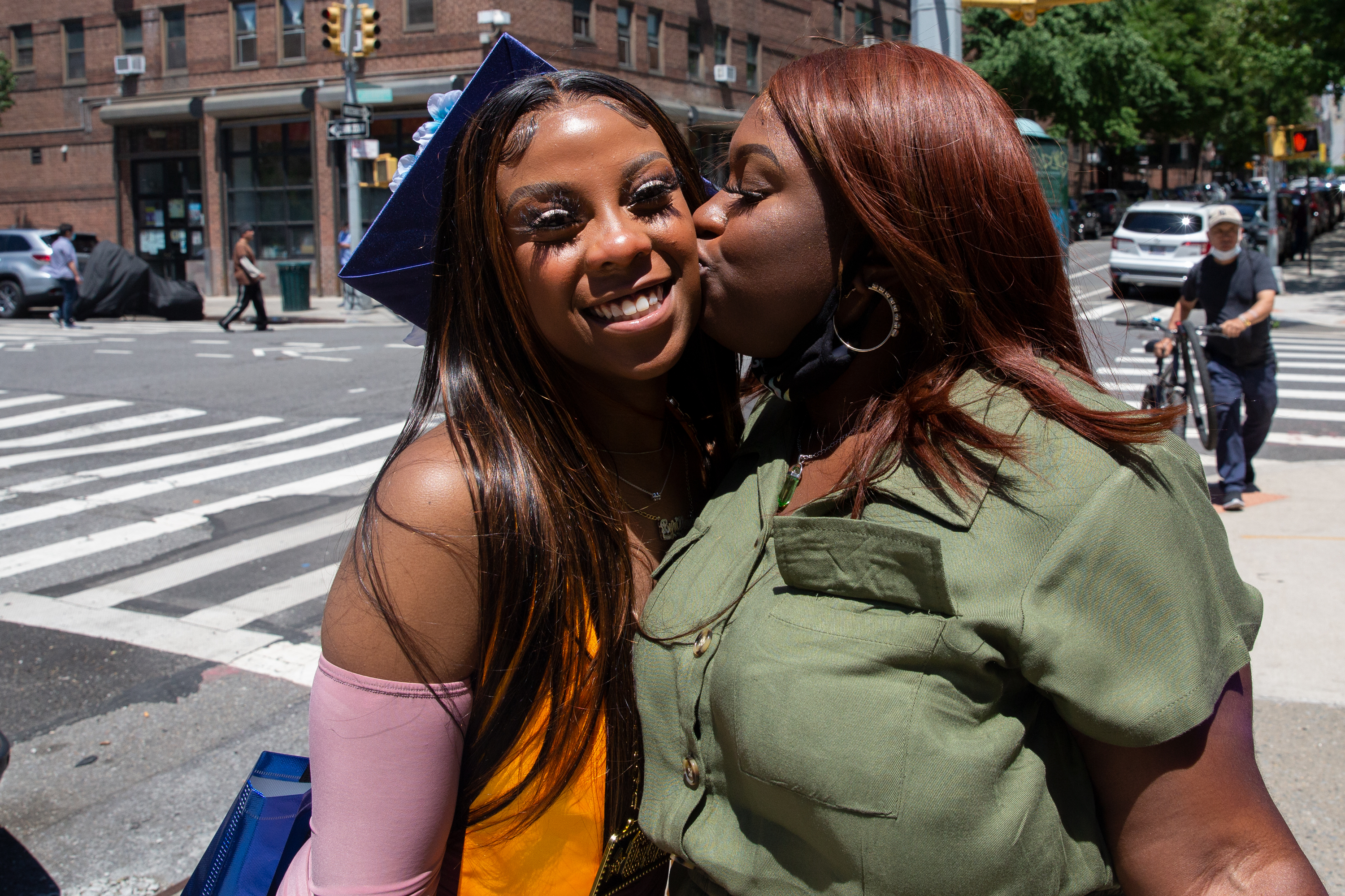 Byri-zyashyia Smith kisses her sister, Byri-vanni, after the younger sibling graduated from the Urban Assembly School for Emergency Management in the Lower East Side on Thursday, June 24, 2021.