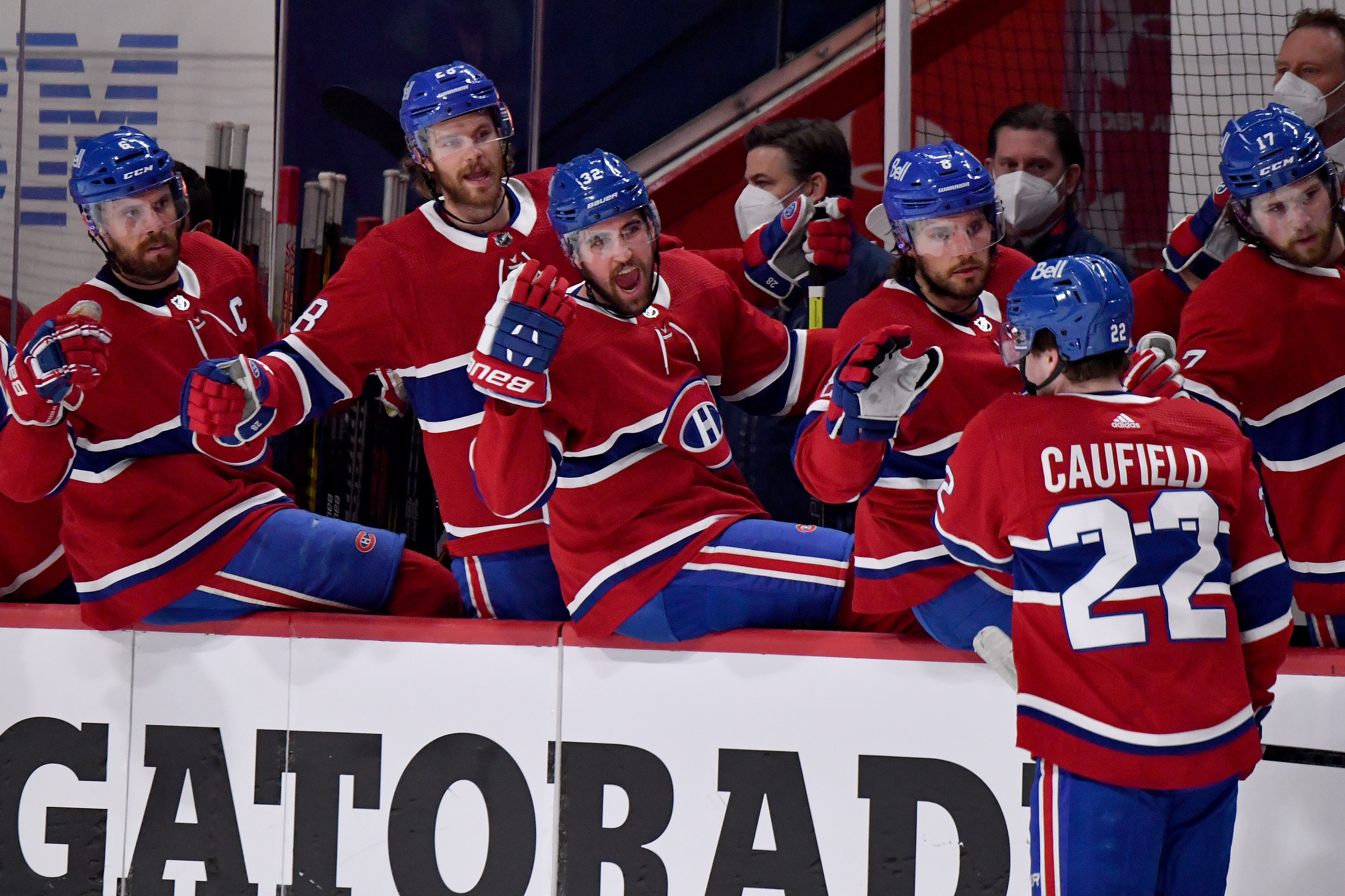 Cole Caufield #22 of the Montreal Canadiens celebrates with Jon Merrill #28, Erik Gustafsson #32 and Ben Chiarot #8 after scoring a goal against Robin Lehner #90 of the Vegas Golden Knights during the second period in Game Six of the Stanley Cup Semifinals of the 2021 Stanley Cup Playoffs at Bell Centre on June 24, 2021 in Montreal, Quebec.