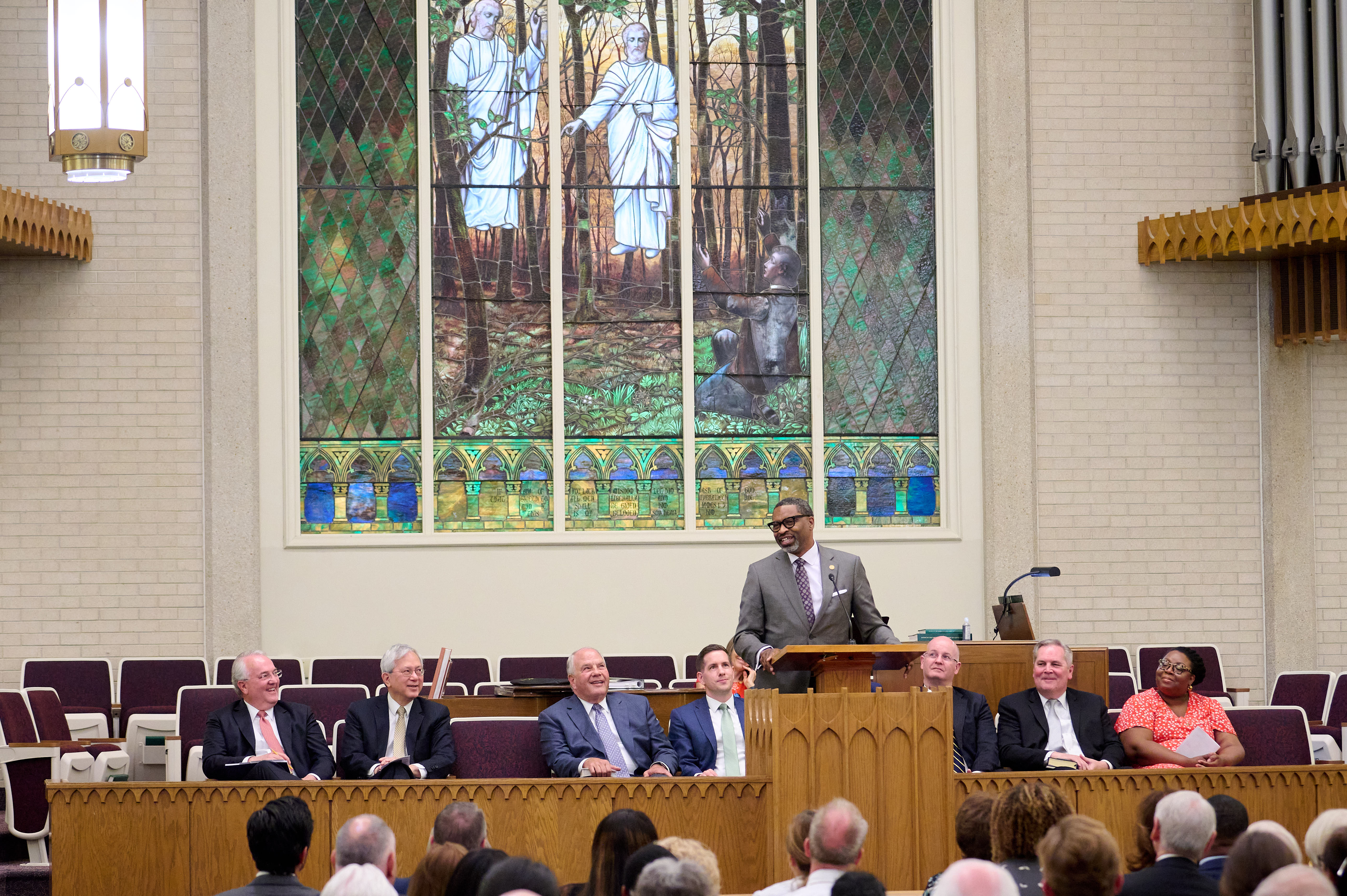 Tracy Browning, far right, listens as NAACP President Derrick Johnson speaks at a Latter-day Saint sacrament meeting.