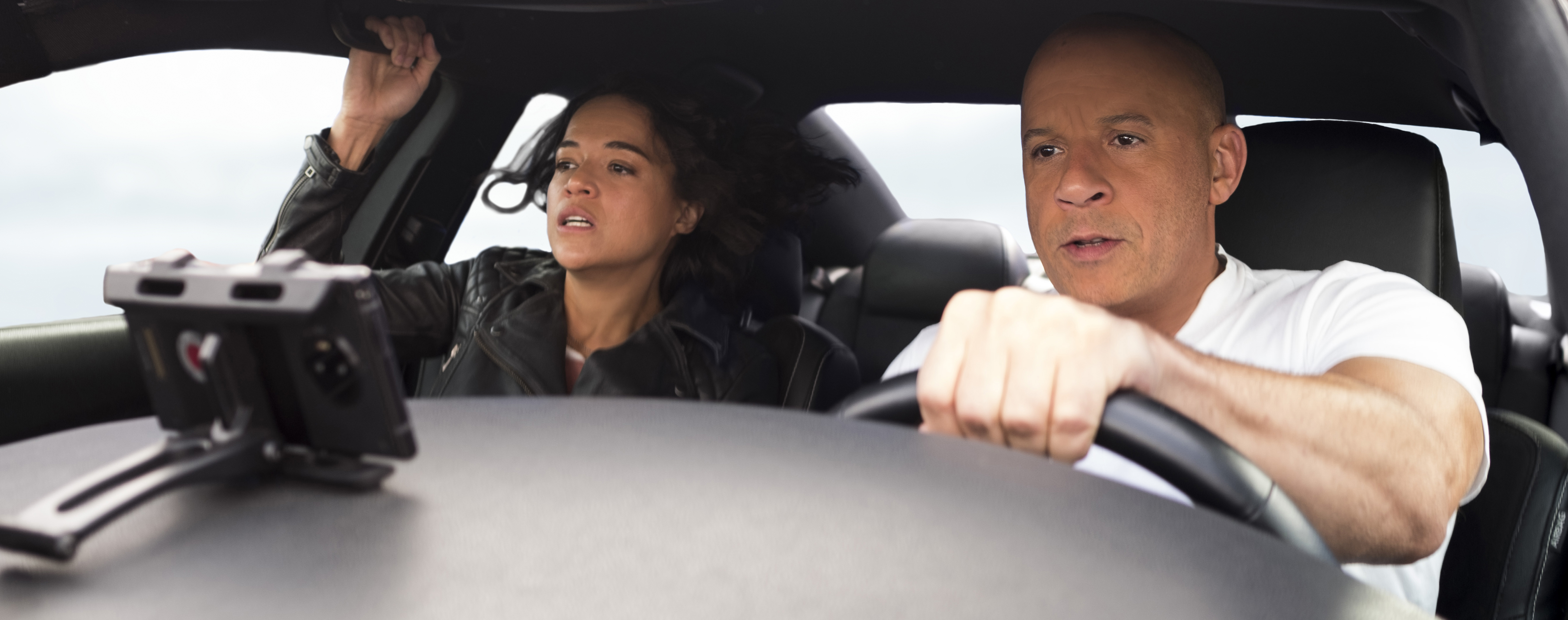 Dom drives while Letty hangs on for dear life.