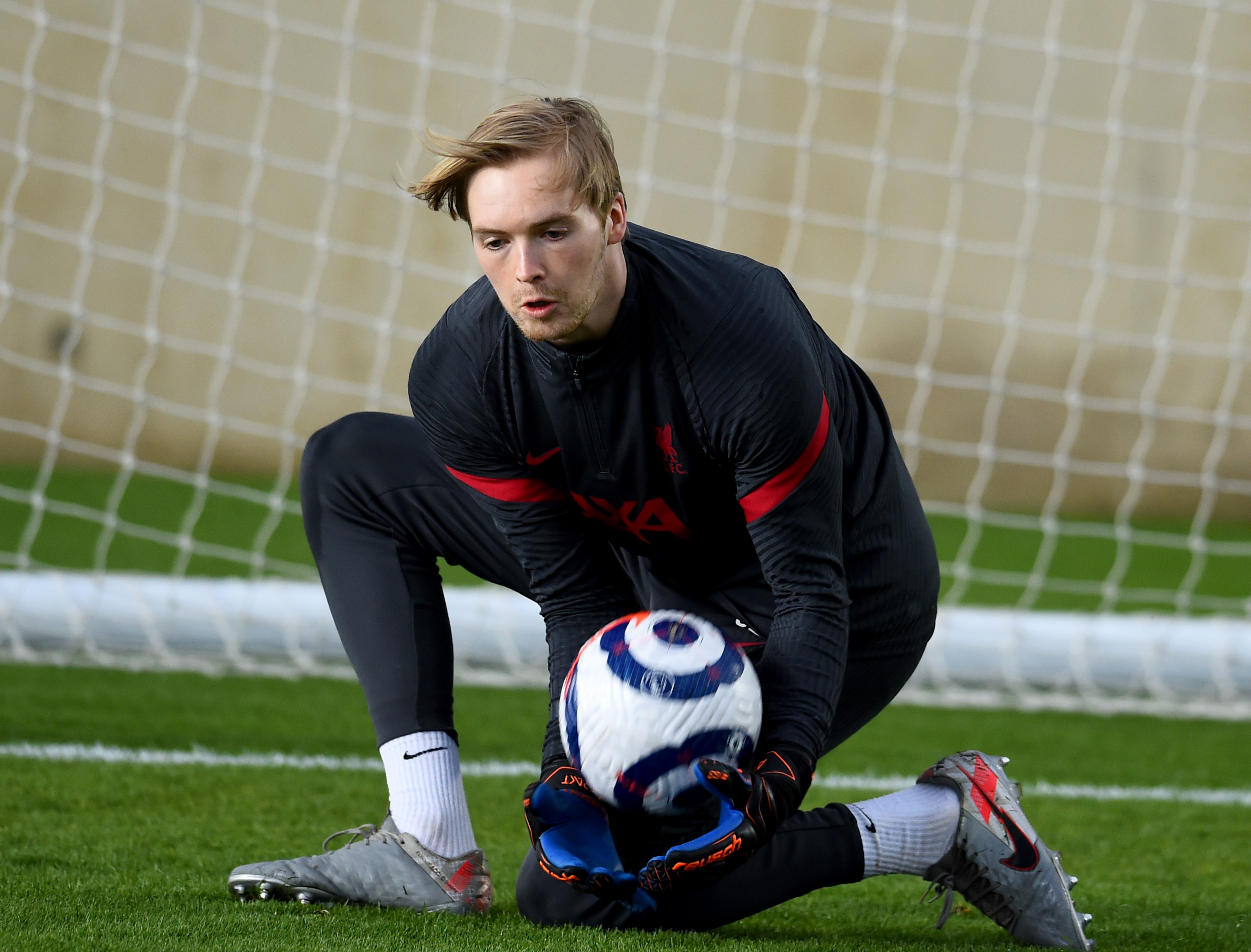 Caoimhin Kelleher of Liverpool during a training session at AXA Training Centre on May 11, 2021 in Kirkby, England.