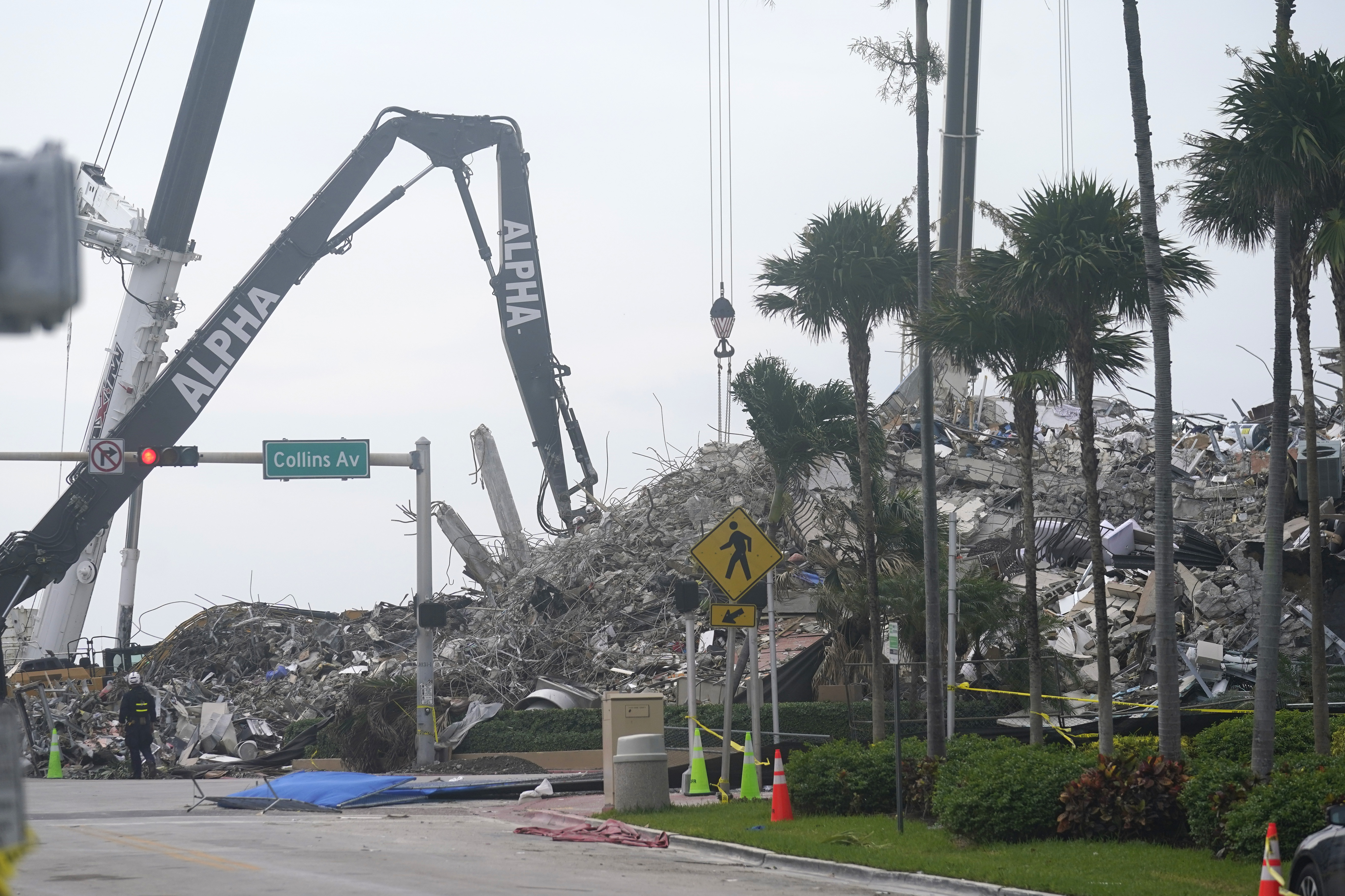 Rescue crews work in the rubble of the collapsed Champlain Towers South condominium building, Tuesday, July 6, 2021, in Surfside, Fla.