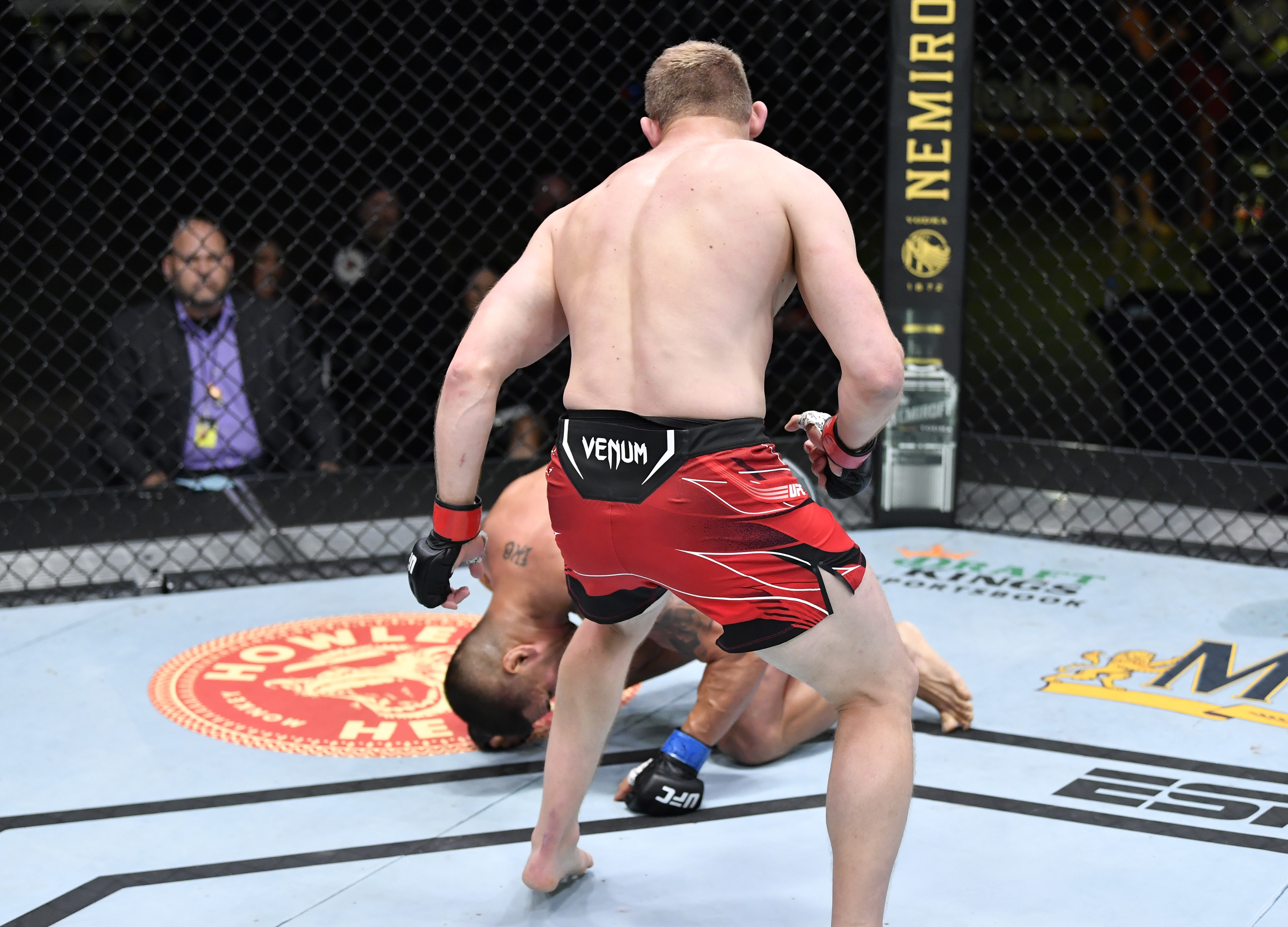 Marcin Prachnio of Poland drops Ike Villanueva with a body kick in a light heavyweight fight during the UFC Fight Night event at UFC APEX on June 26, 2021 in Las Vegas, Nevada.