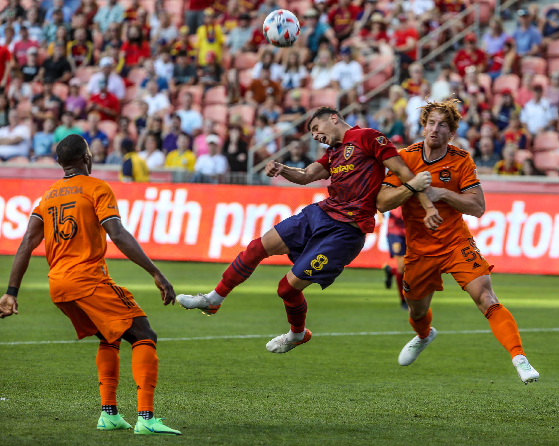 Real Salt Lake midfielder Damir Kreilach (8) battles Houston Dynamo defender Tim Parker (5) for the ball