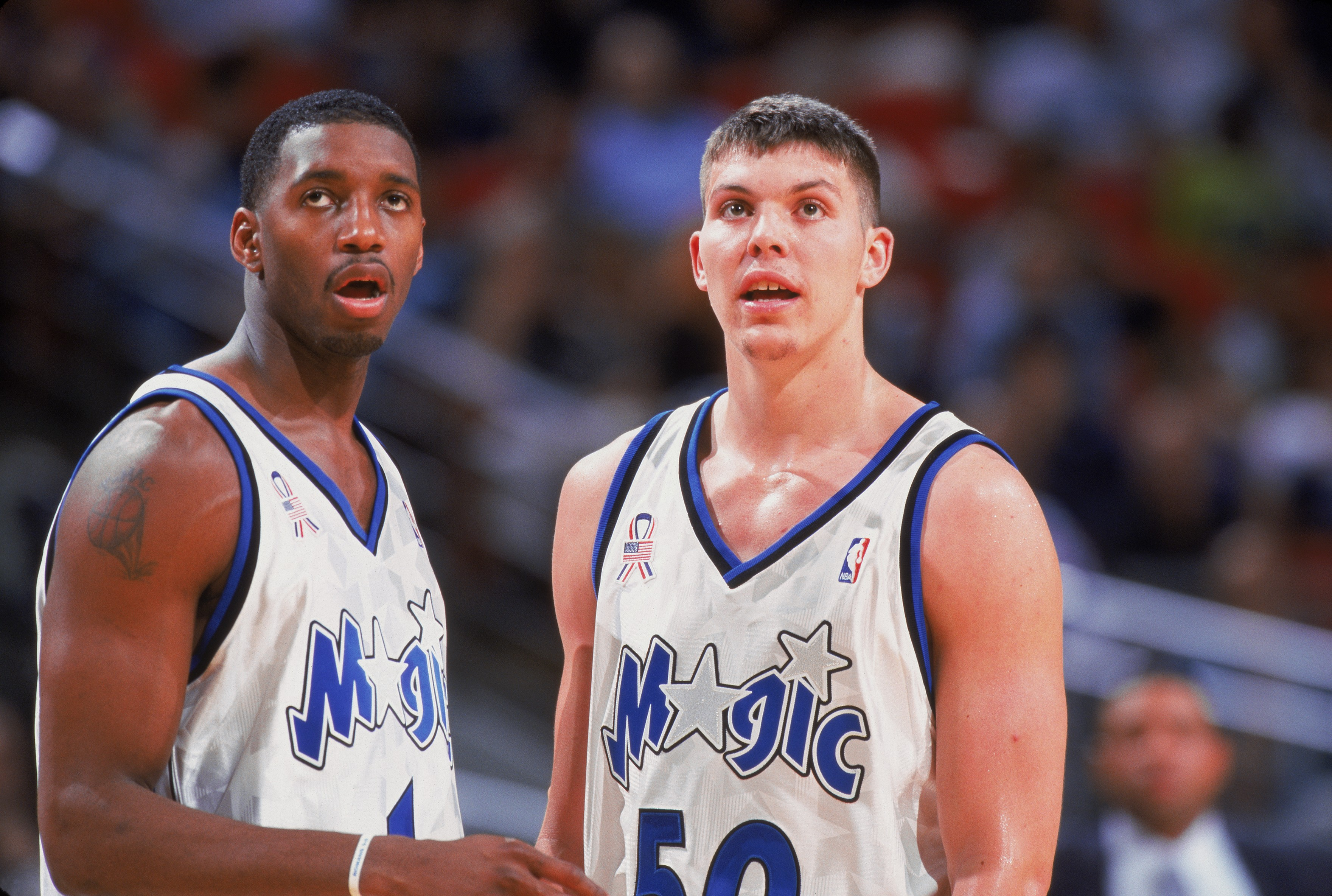 Tracy McGrady #1, Mike Miller #50