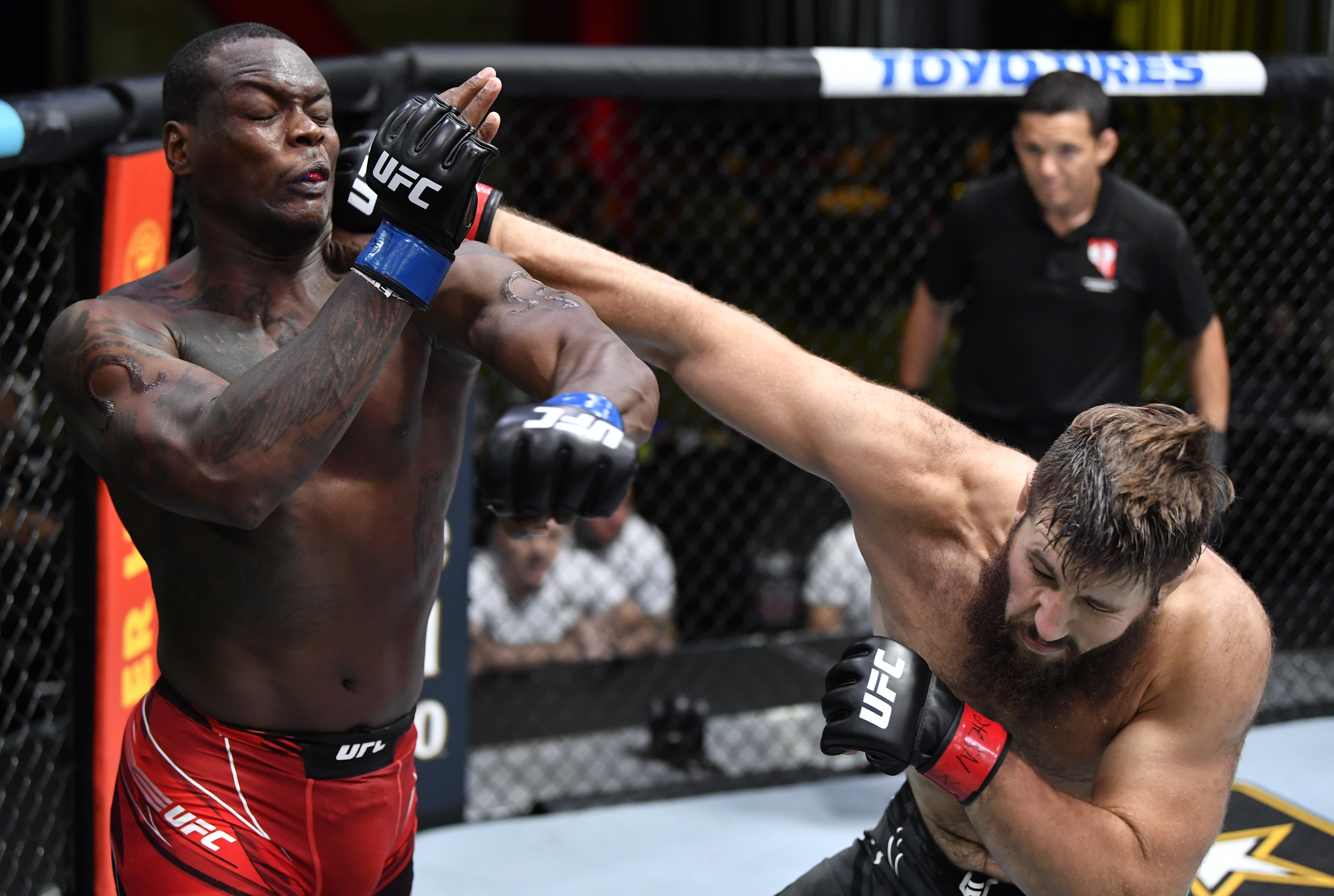 Tanner Boser punches Ovince Saint Preux during their fight at UFC Vegas 30