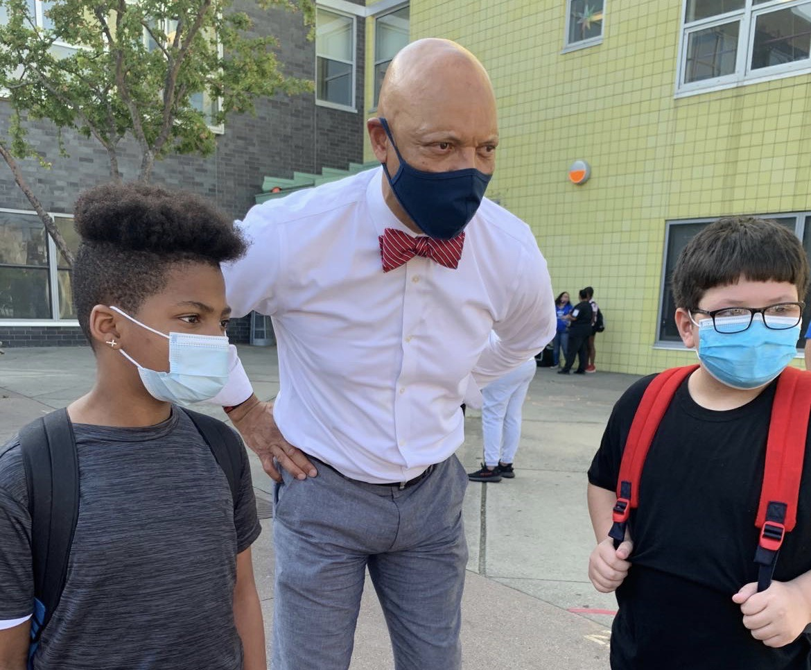 Philadelphia Superintendent William Hite with two students outside Hunter Elementary School