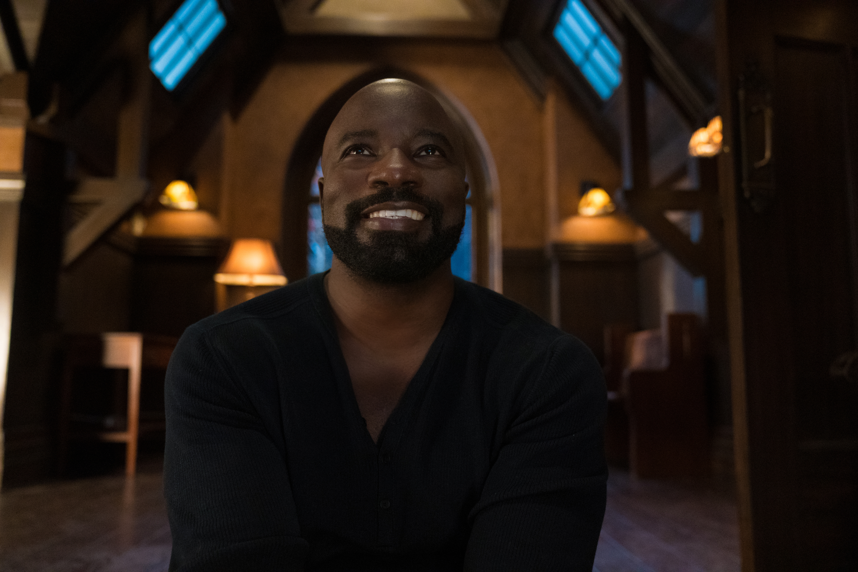 David Acosta (Mike Colter) smiles unsettlingly in a still from season 2 of Evil on Paramount Plus
