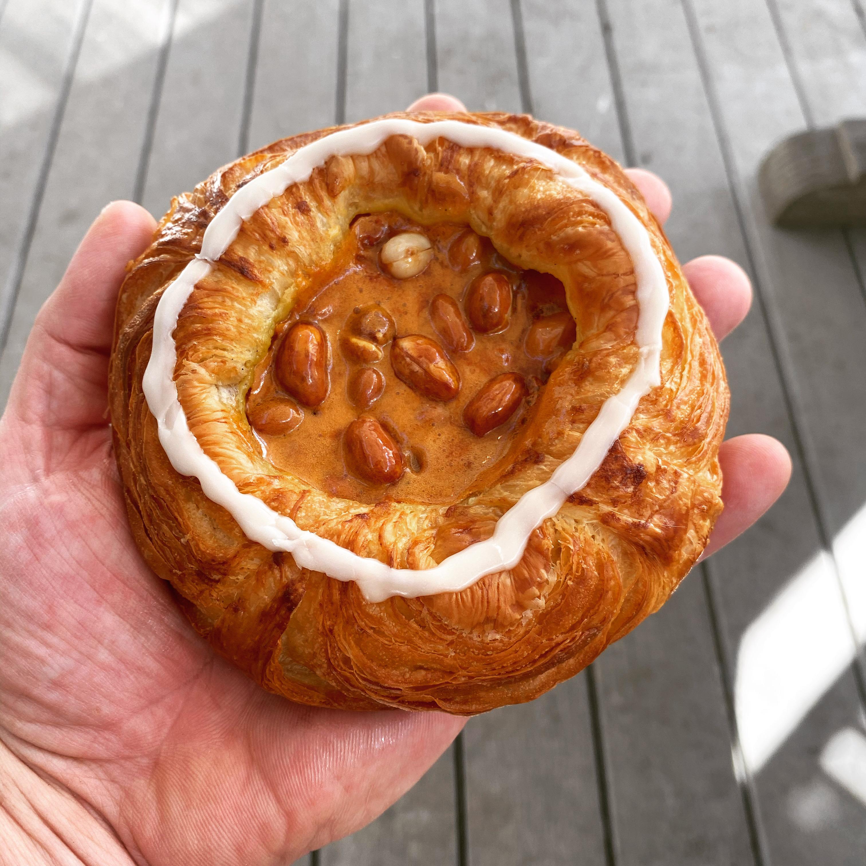A Danish made with vanilla cream, peanut brittle, and a Dr Pepper glaze.