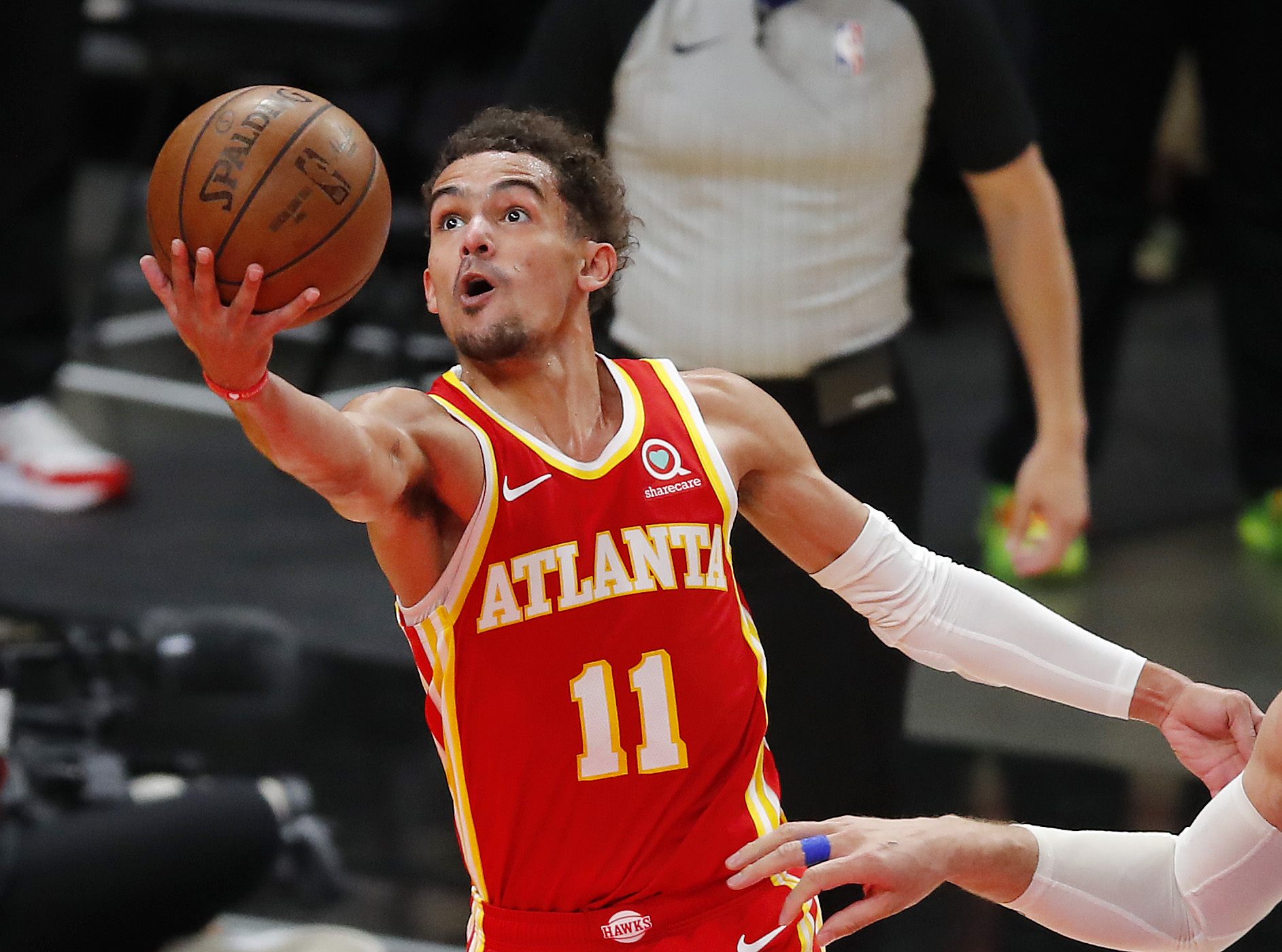 Trae Young #11 of the Atlanta Hawks goes up for a shot against the Milwaukee Bucks during the second half in game three of the Eastern Conference Finals at State Farm Arena on June 27, 2021 in Atlanta, Georgia.