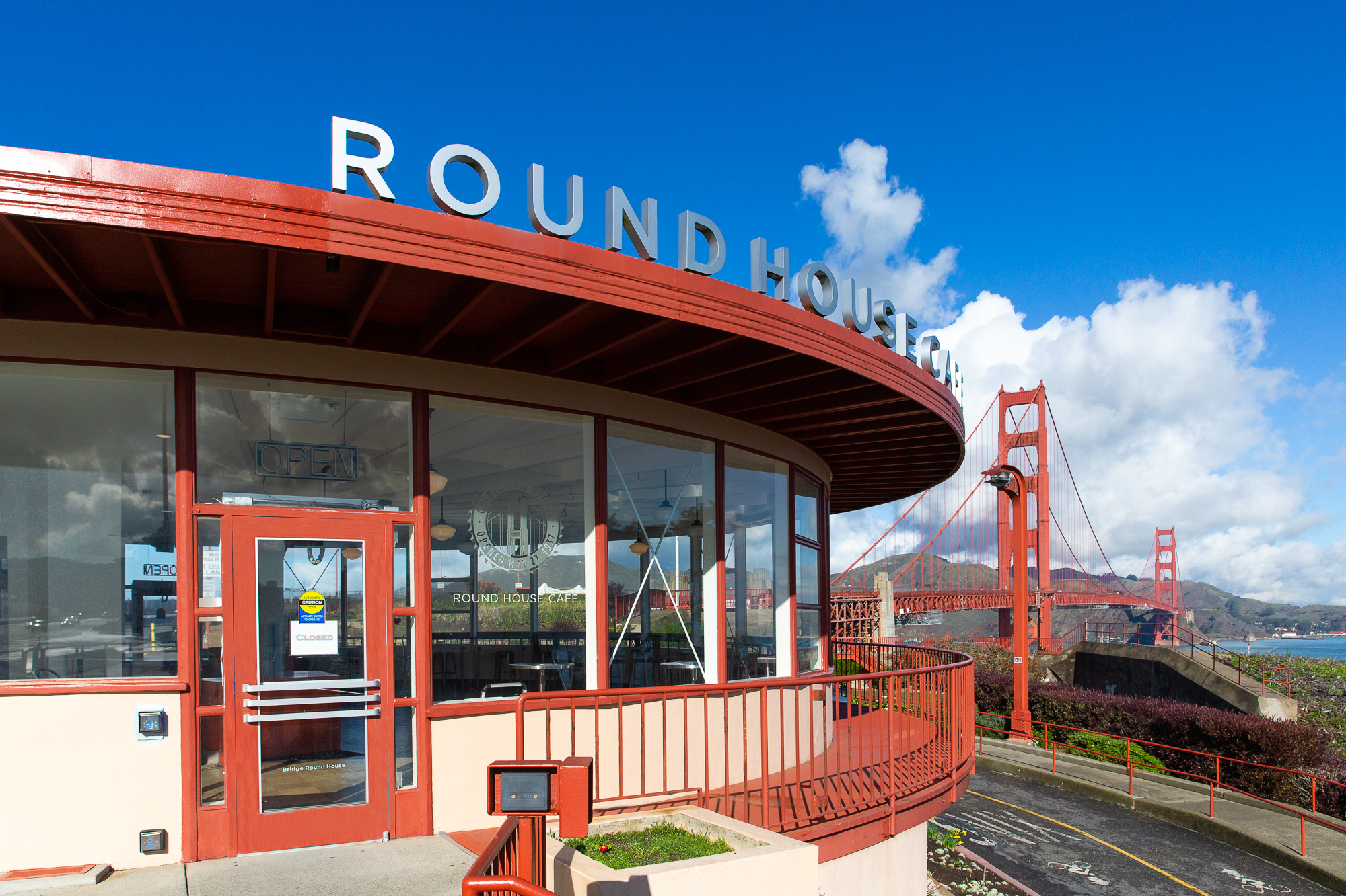 Exterior of Round House Cafe, with Golden Gate Bridge in background