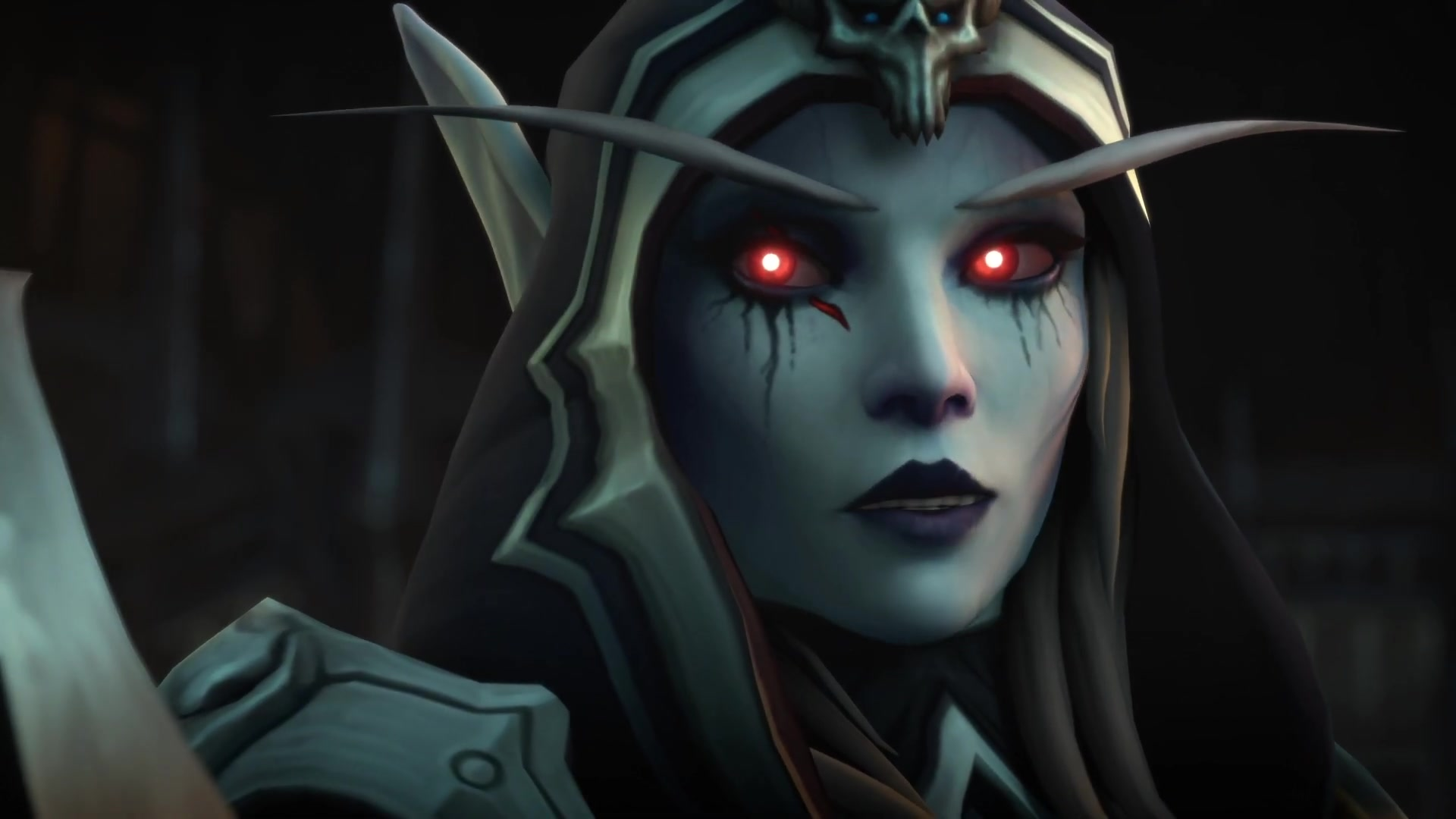World of Warcraft: Shadowlands - Sylvanas Windrunner, an undead elf with bright red eyes, speaks to a figure off-camera with a hopeful expression.