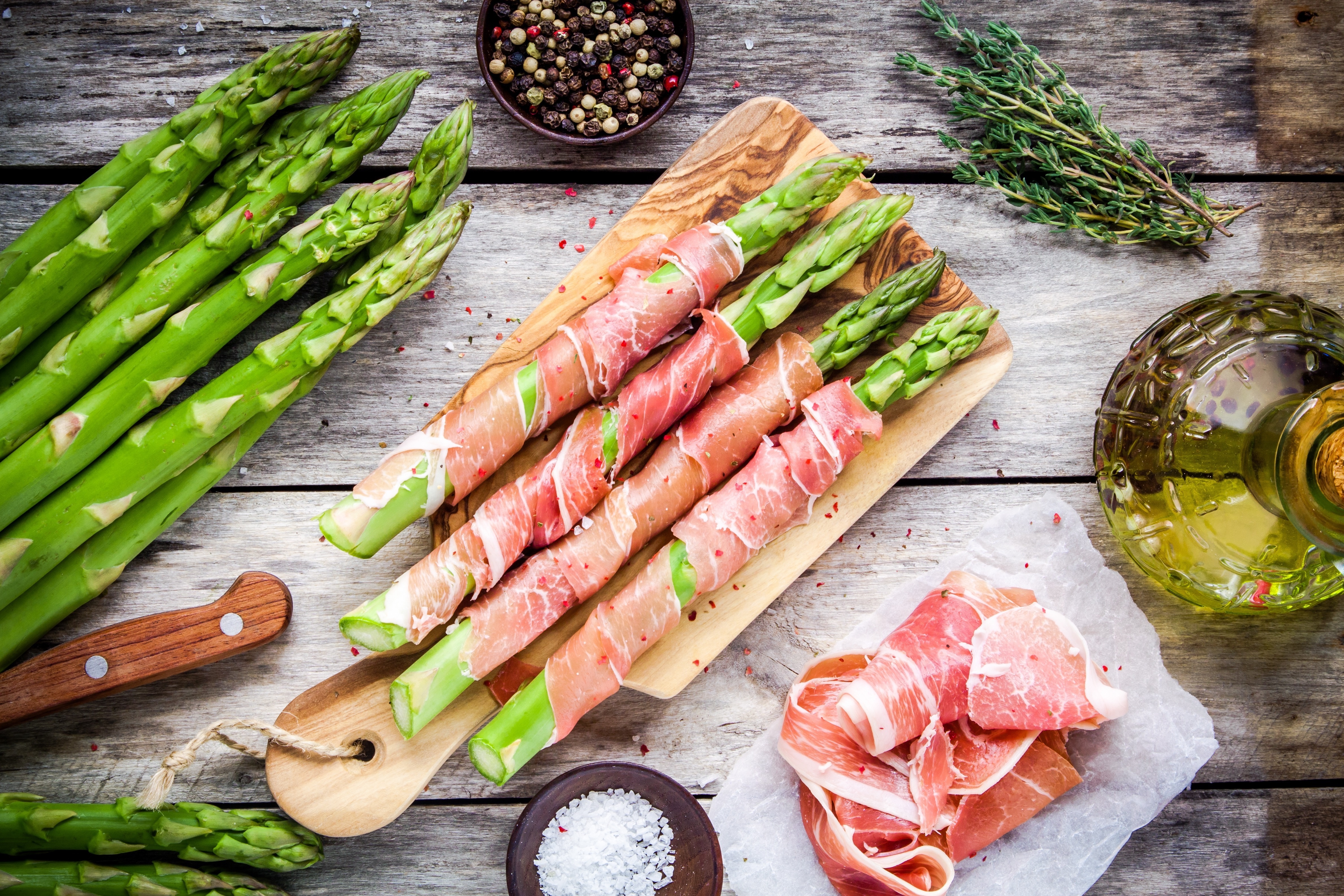 Prosciutto-wrapped asparagus are easily assembled in advance and ready to pop into the oven or on the grill when you are ready to serve. They make a great appetizer to pass around while the rest of your meal is cooking.