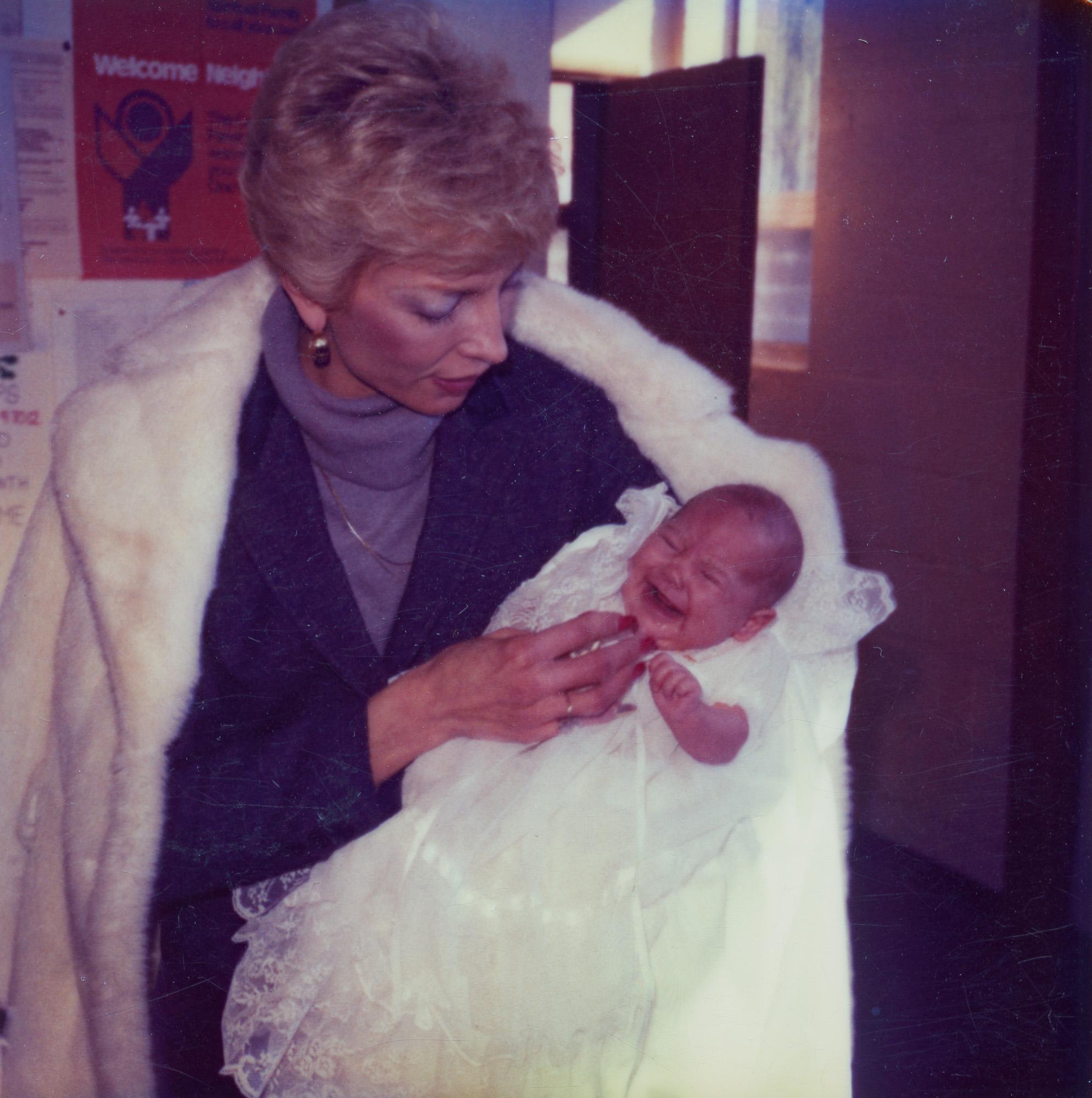 Joyce Yost holds one of her newborn granddaughters