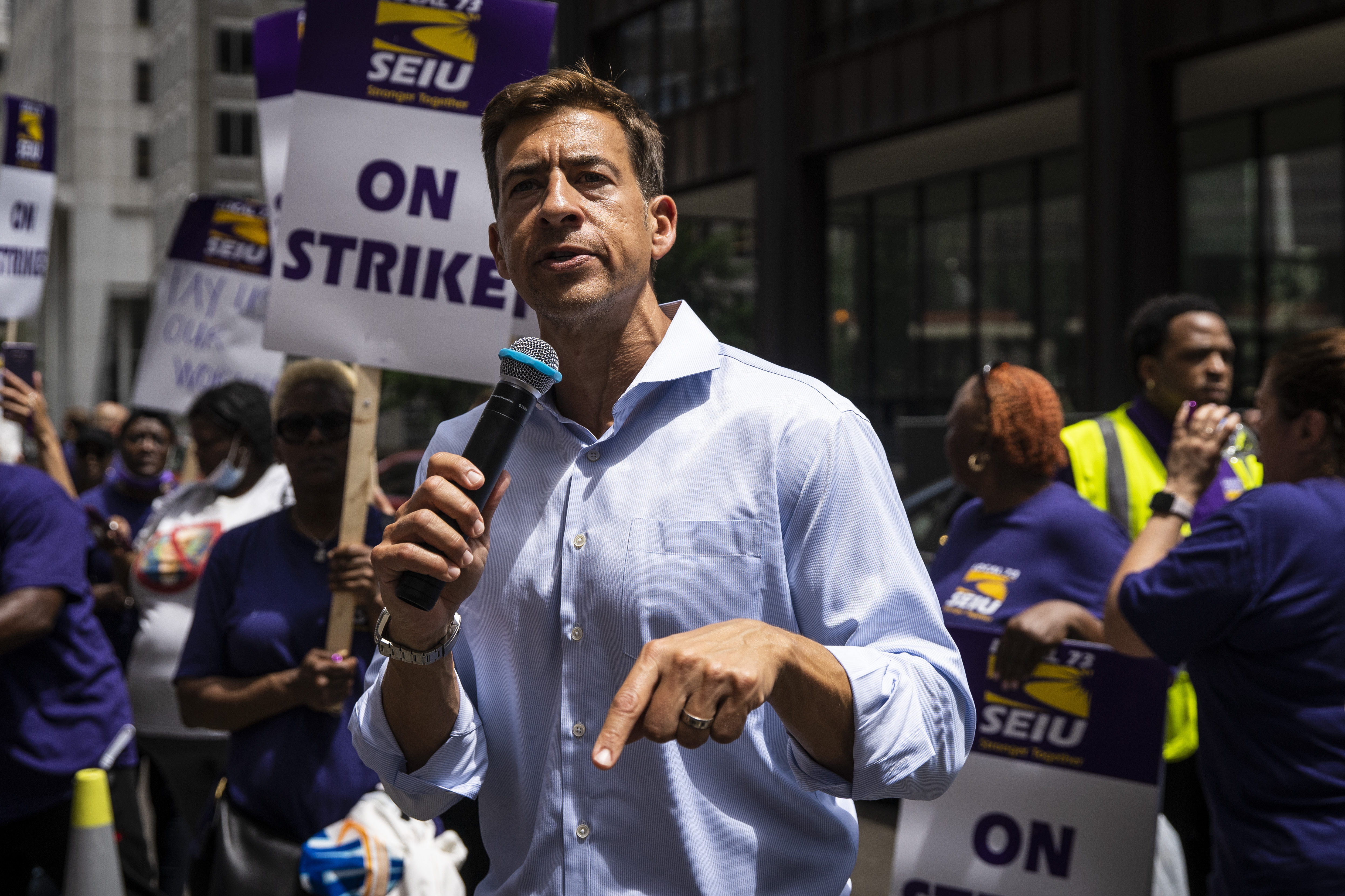 Democratic secretary of state candidate Alexi Giannoulias speaks to striking SEIU Local 73 Cook County workers rallying outside the Cook County Building at 118 N. Clark St. on Tuesday.