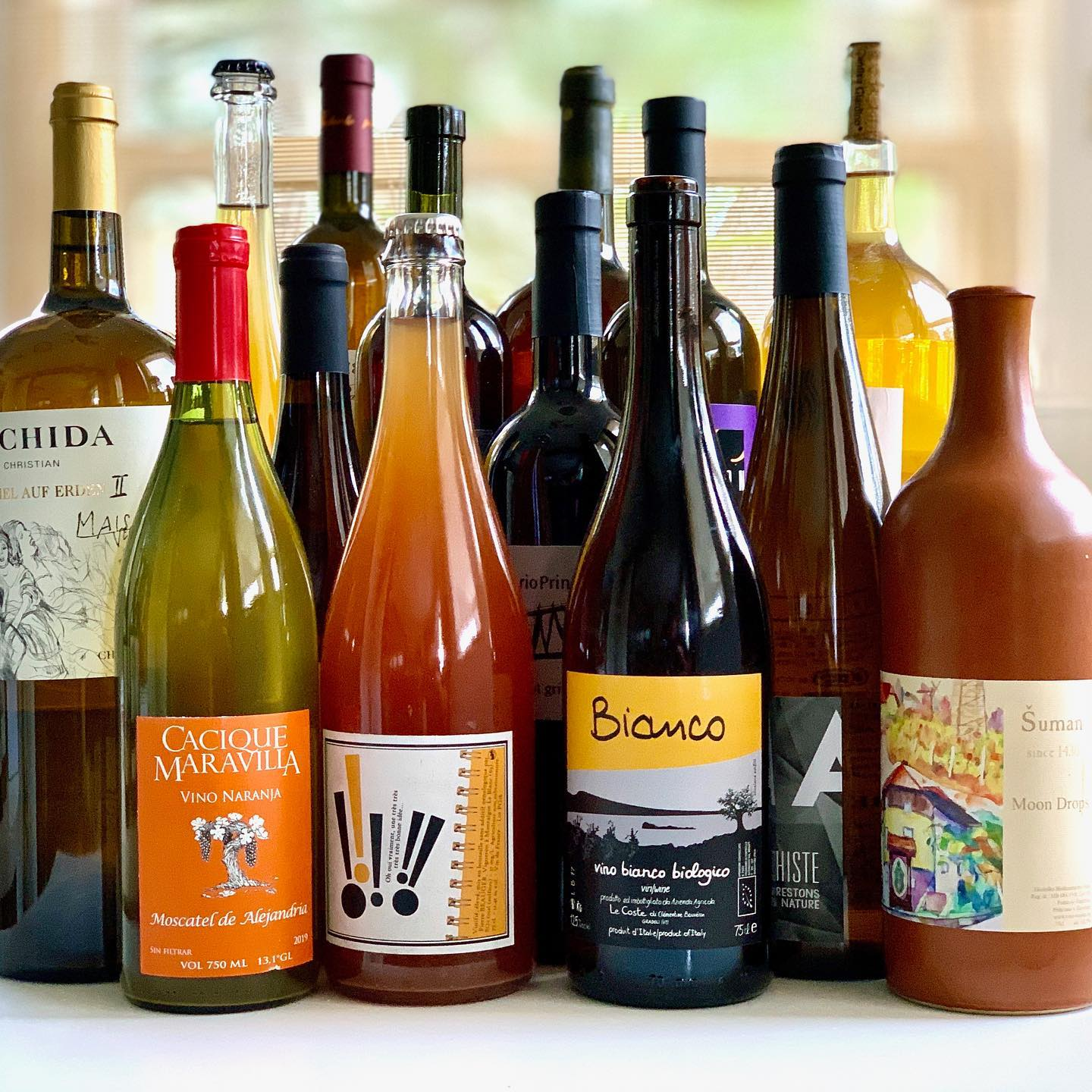 A collection of bottles of wine with colorful labels